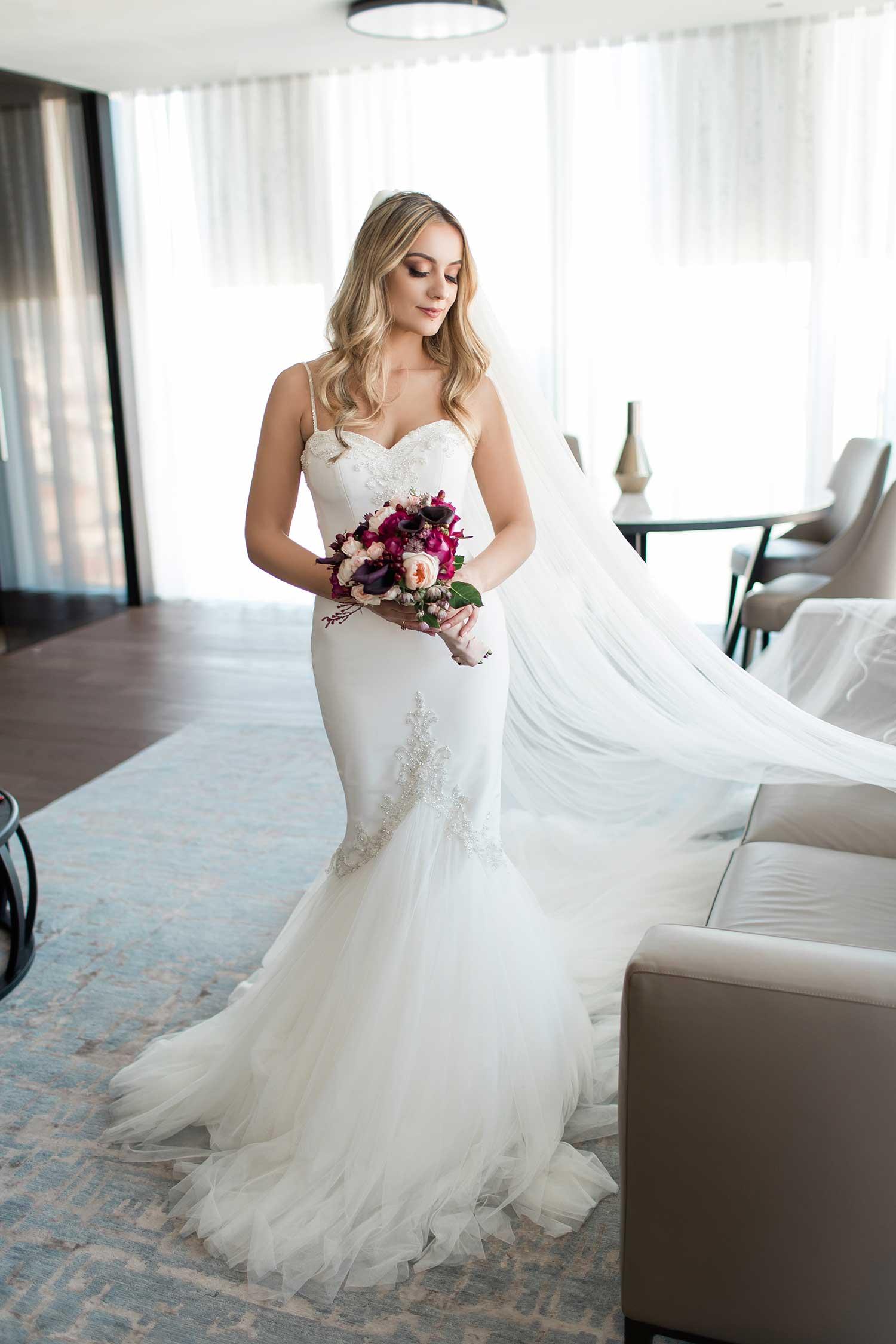 Blonde bride with flower bouquet