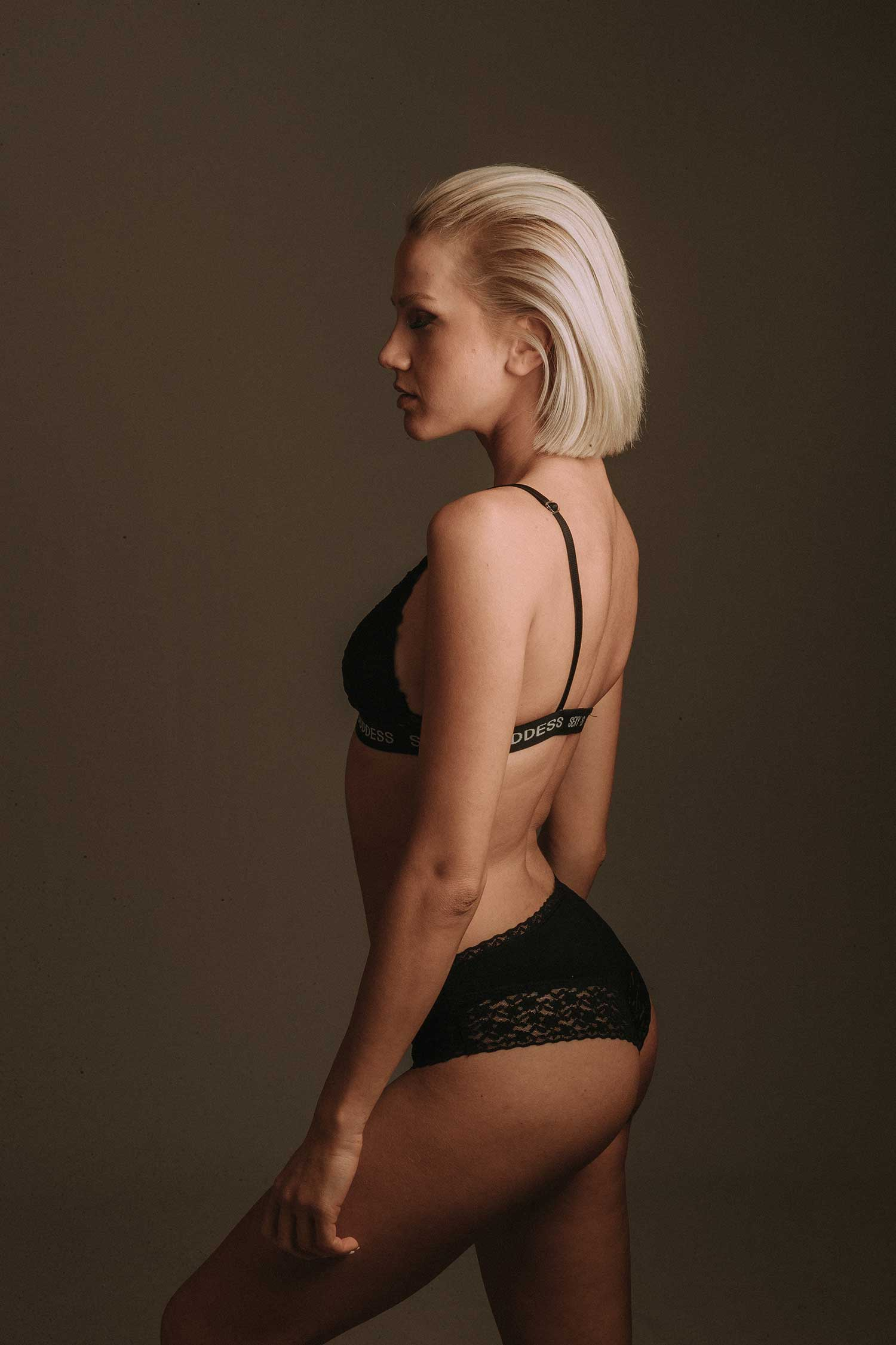 Blonde girl feeling confident about her body