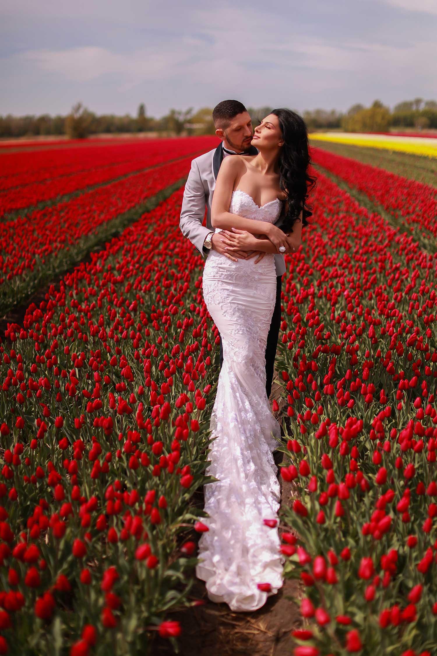 Bride and groom in tulip field