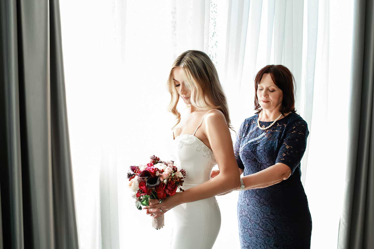 Bride getting ready with her mother