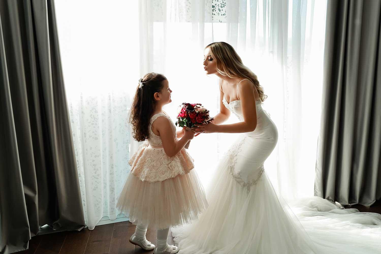 Bride kissing the little girl