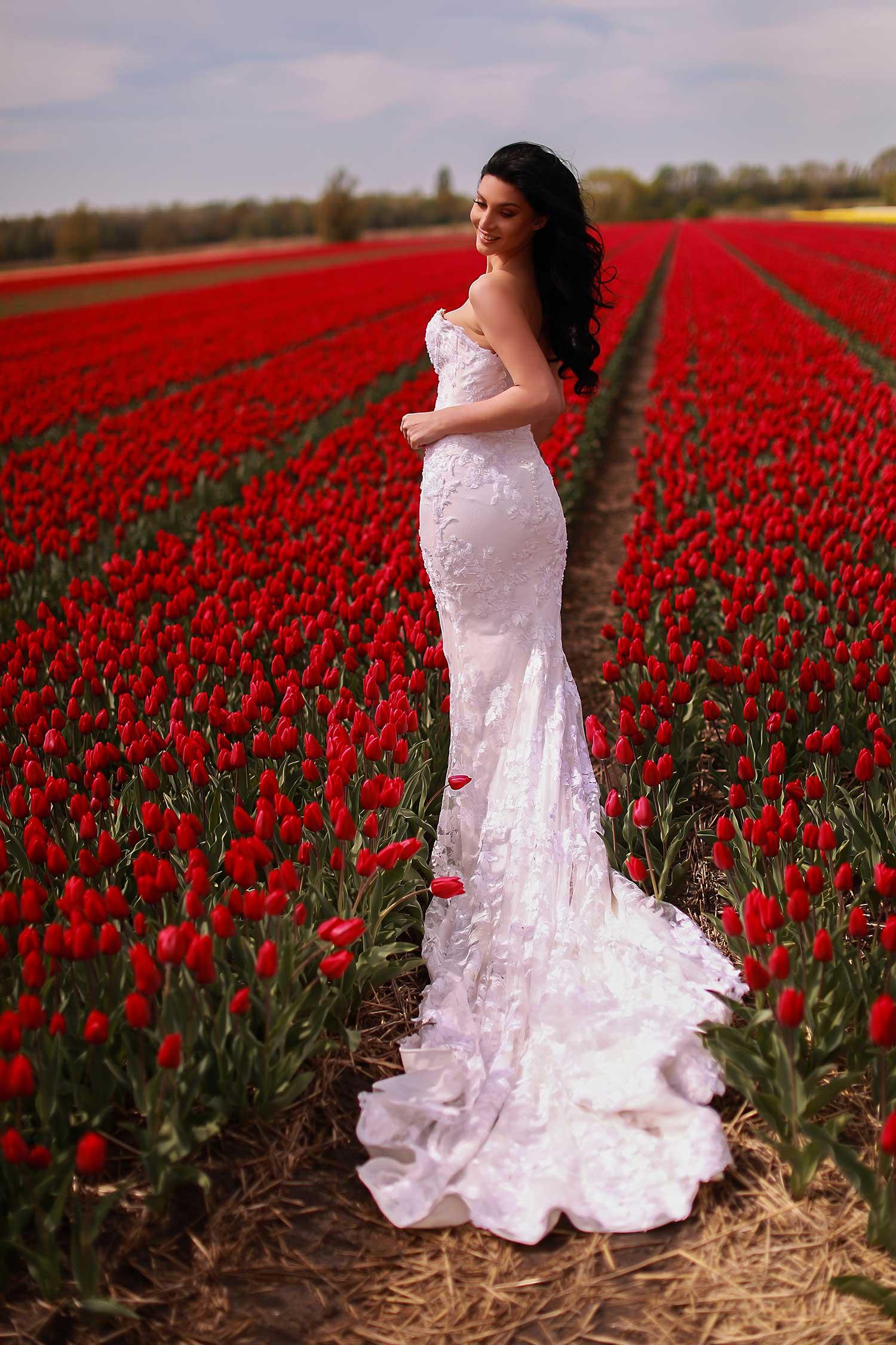 Bride posing in tulip field