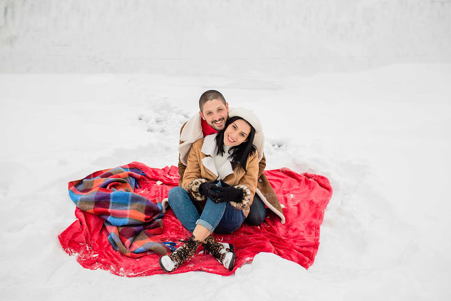 Couple sitting in a red blanket