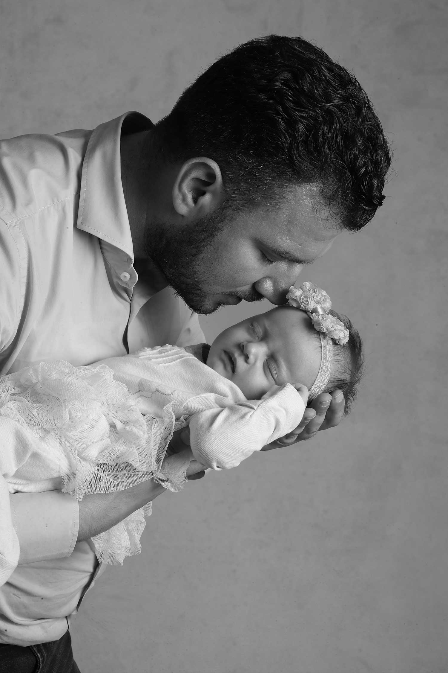 Father and new born baby studio photography