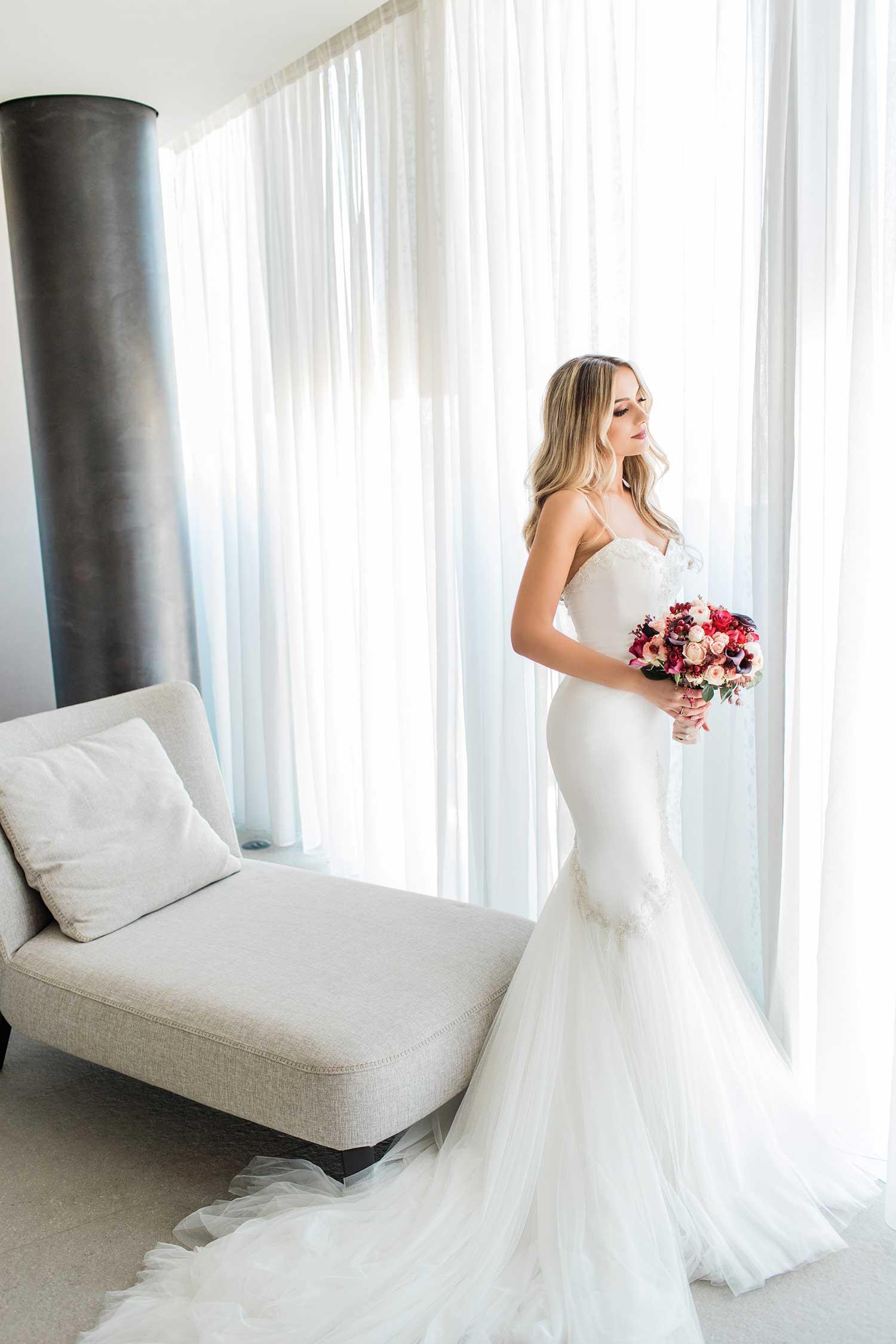 Gorgeous bride wearing white wedding dress