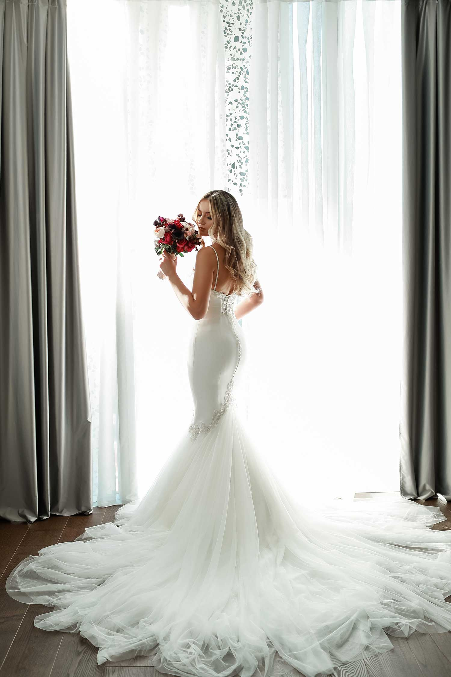 Lovely bride posing at the window