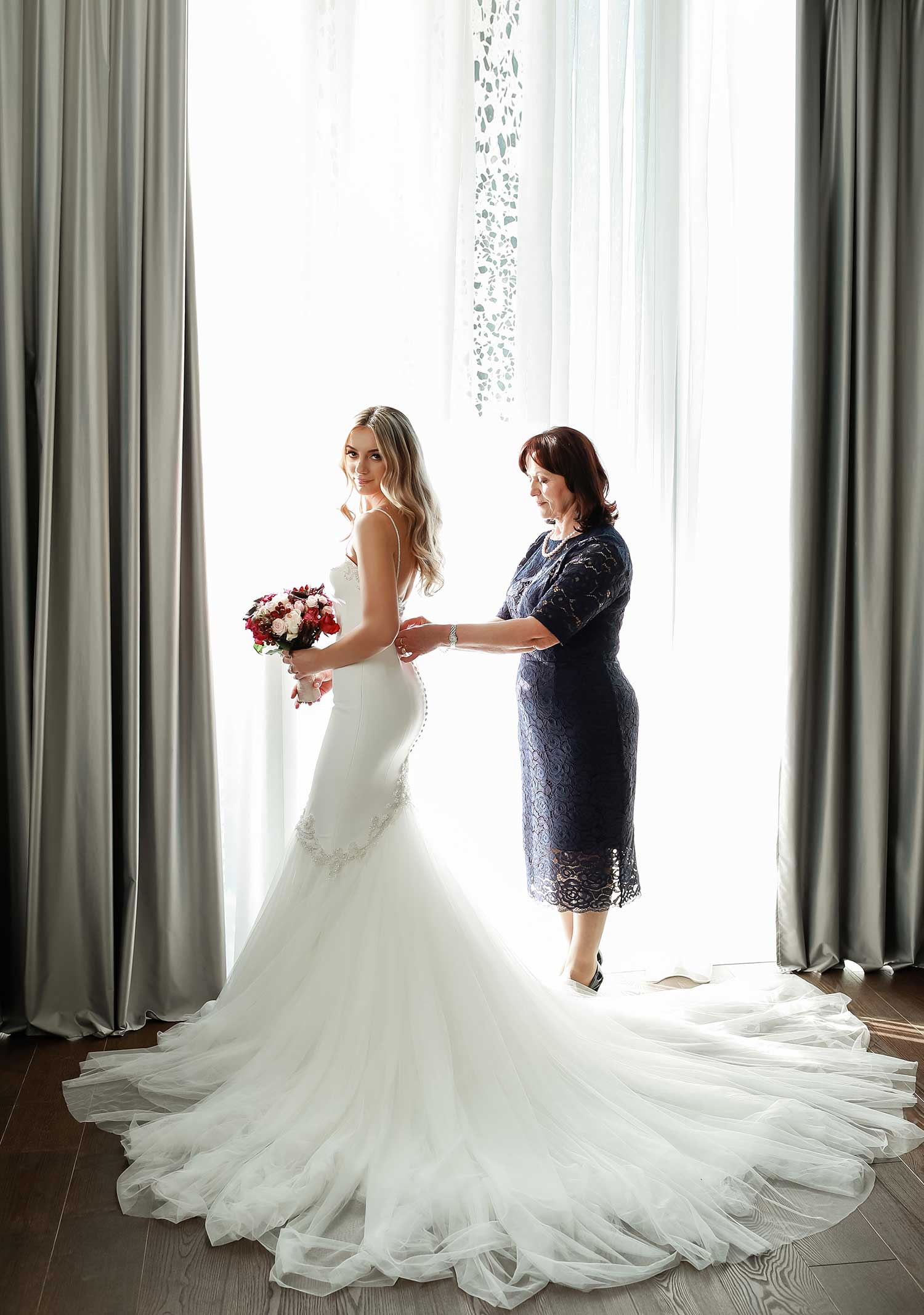 Mother and bride getting ready
