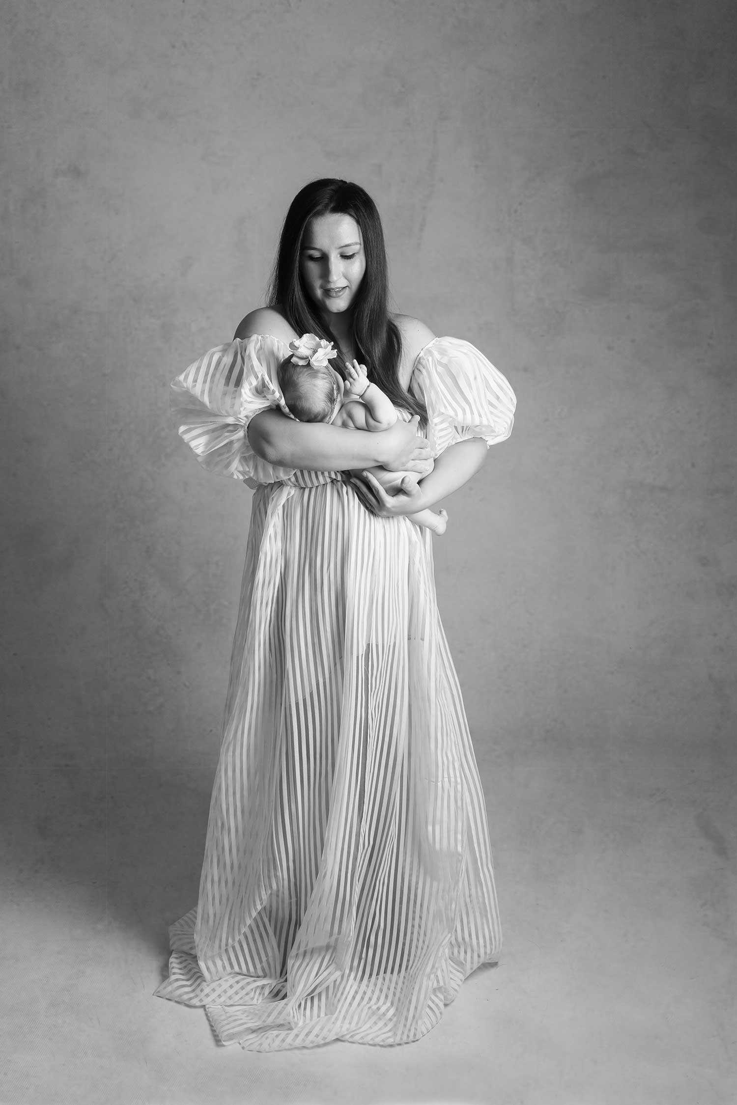 Mother and new born baby studio photography