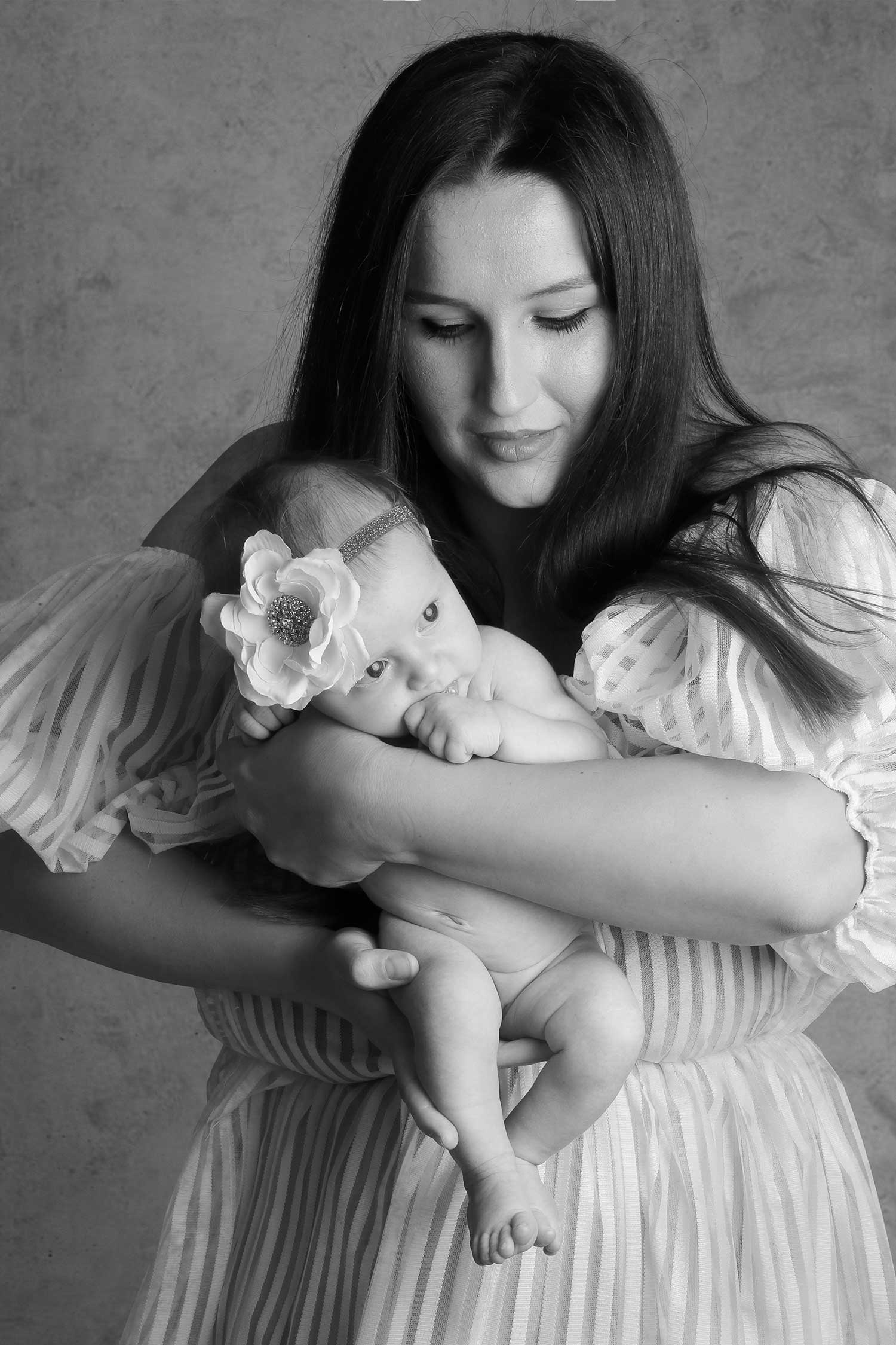 Mother holding her new born baby photography