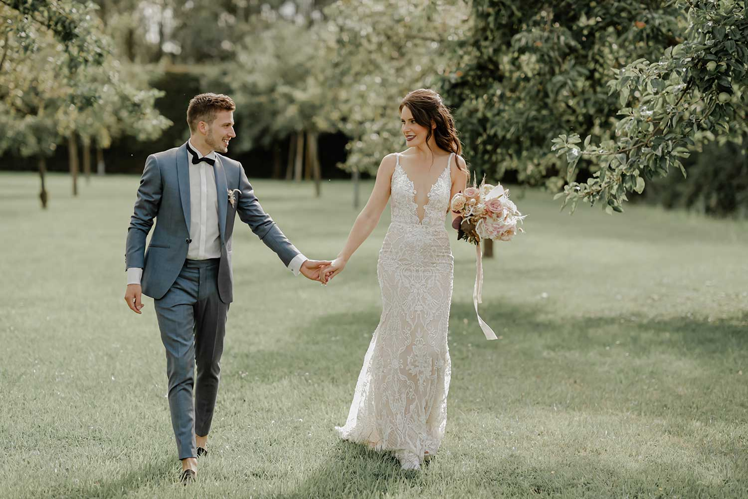 The couple walking together hand in hand