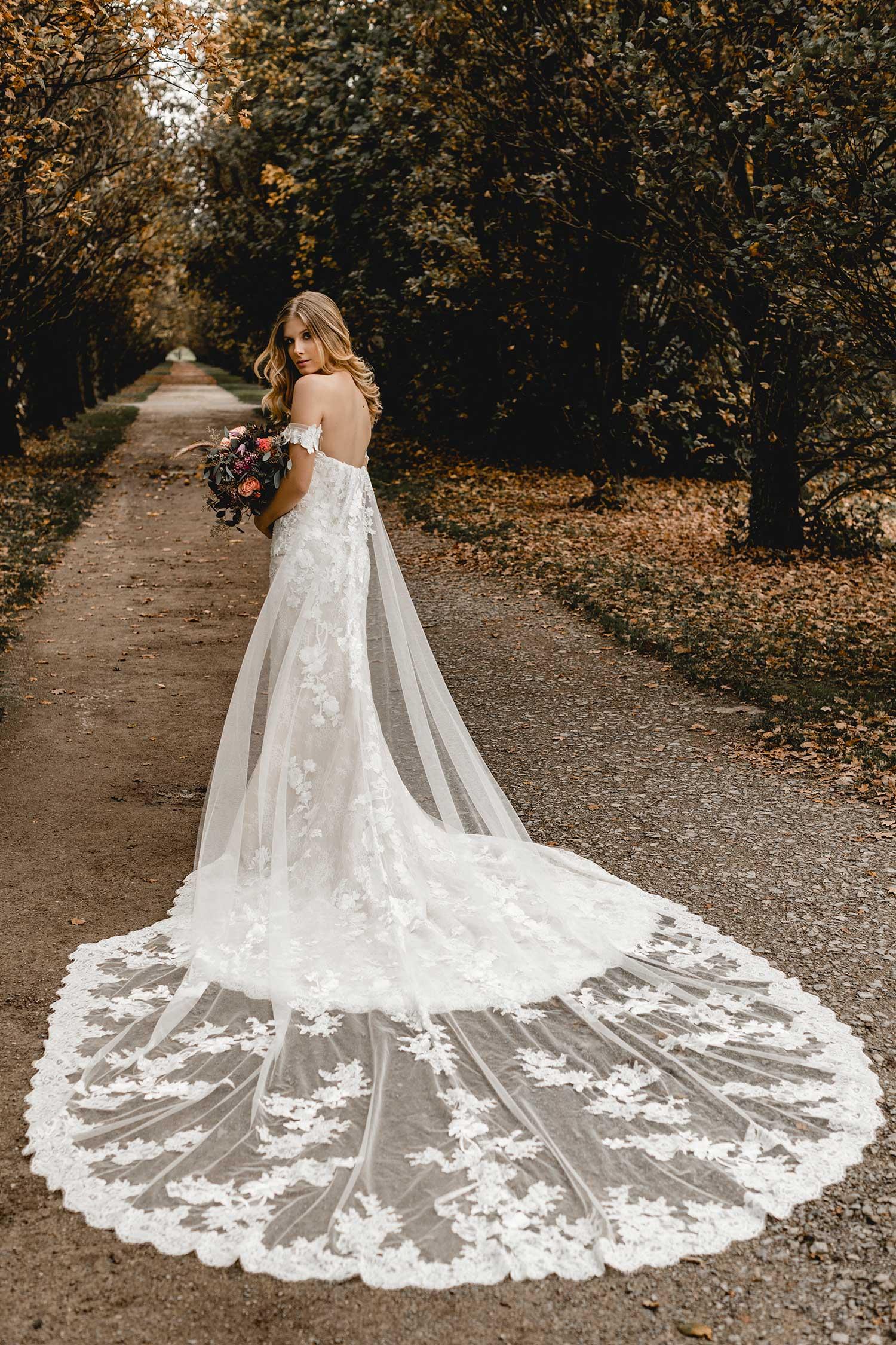An elegant wedding dress in the park