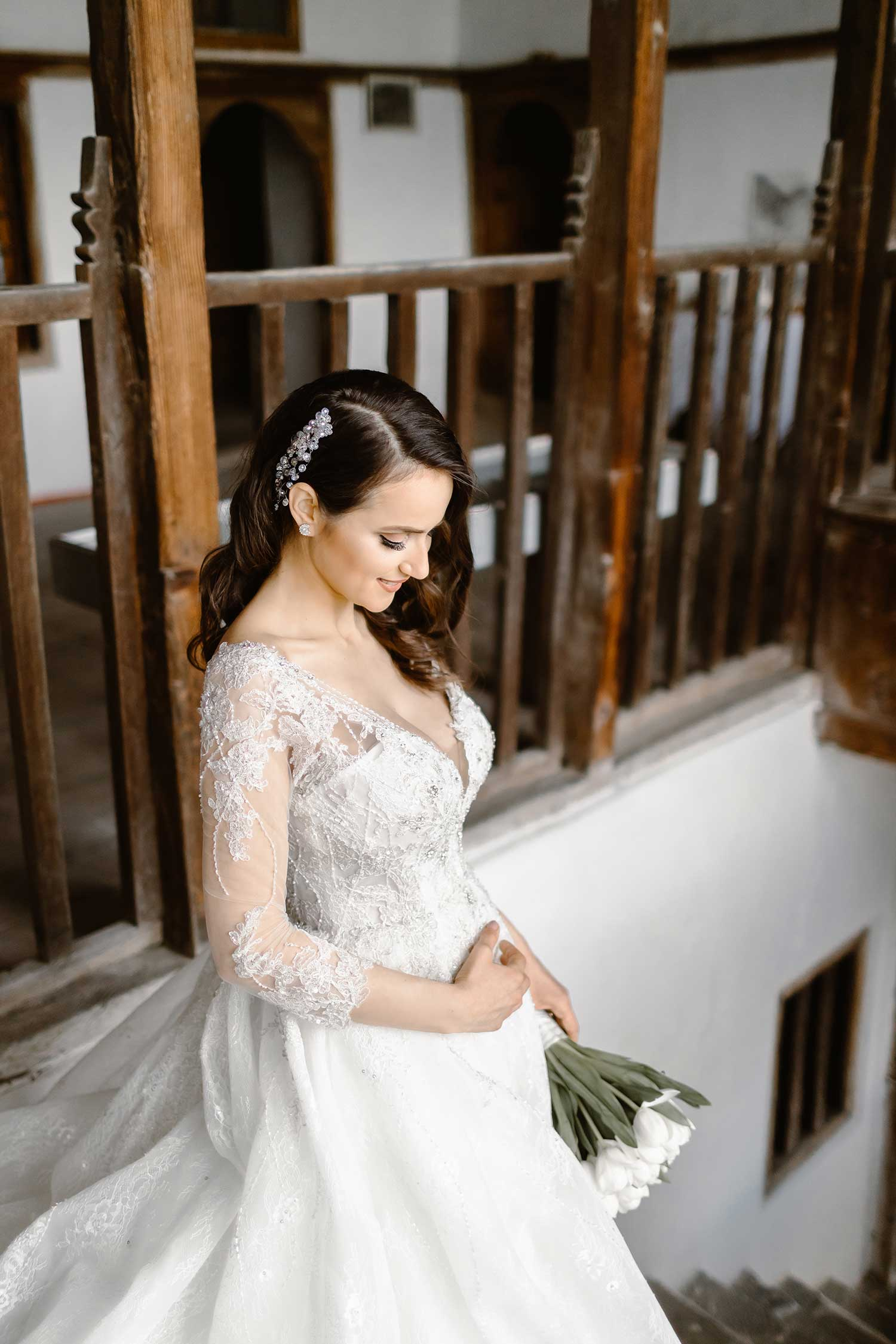 Beautiful bride posing in the stairs of the house