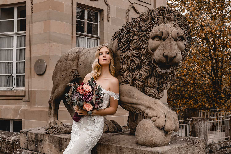 Bridal model posing near a statue