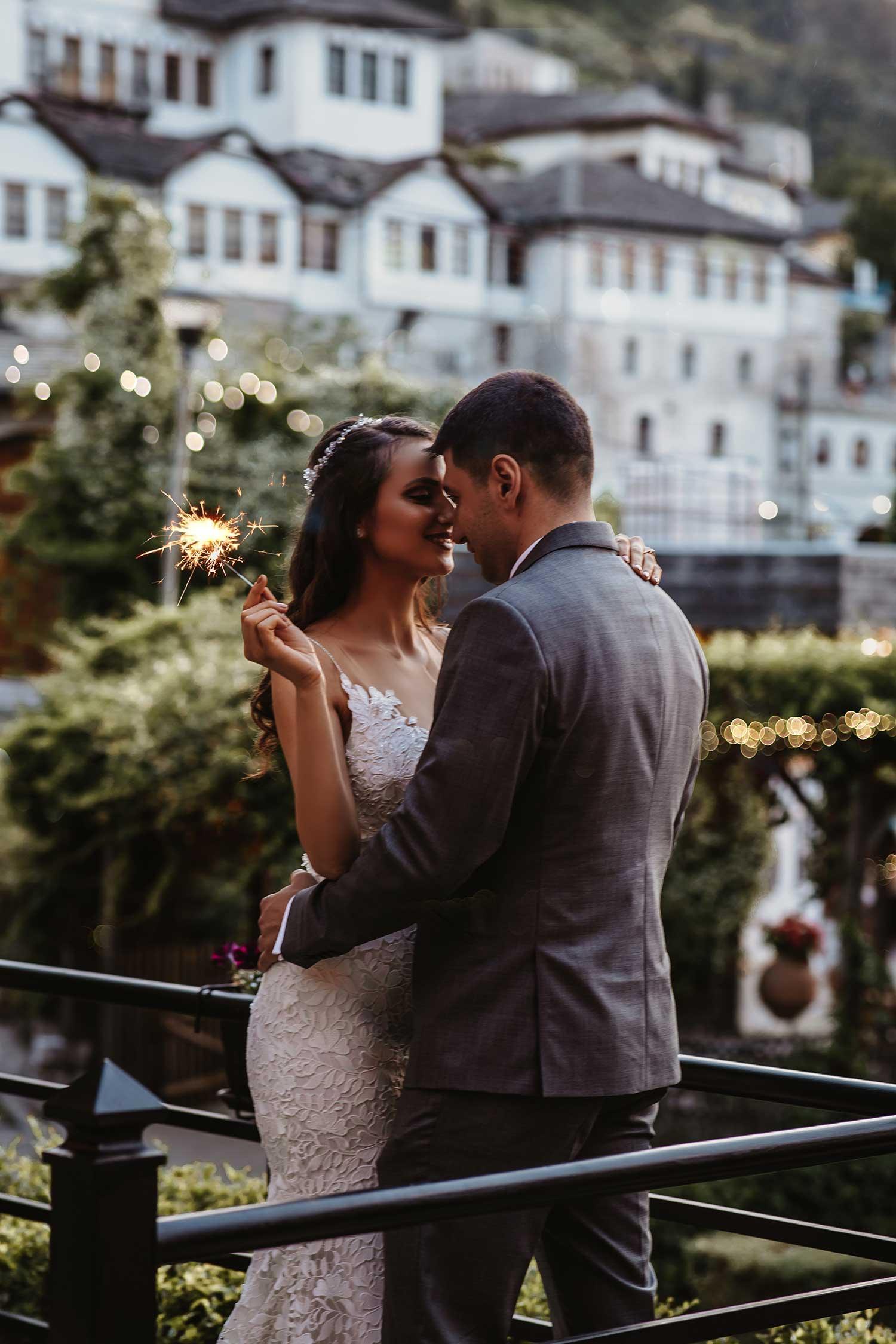 Bride and groom lightning the fireworks