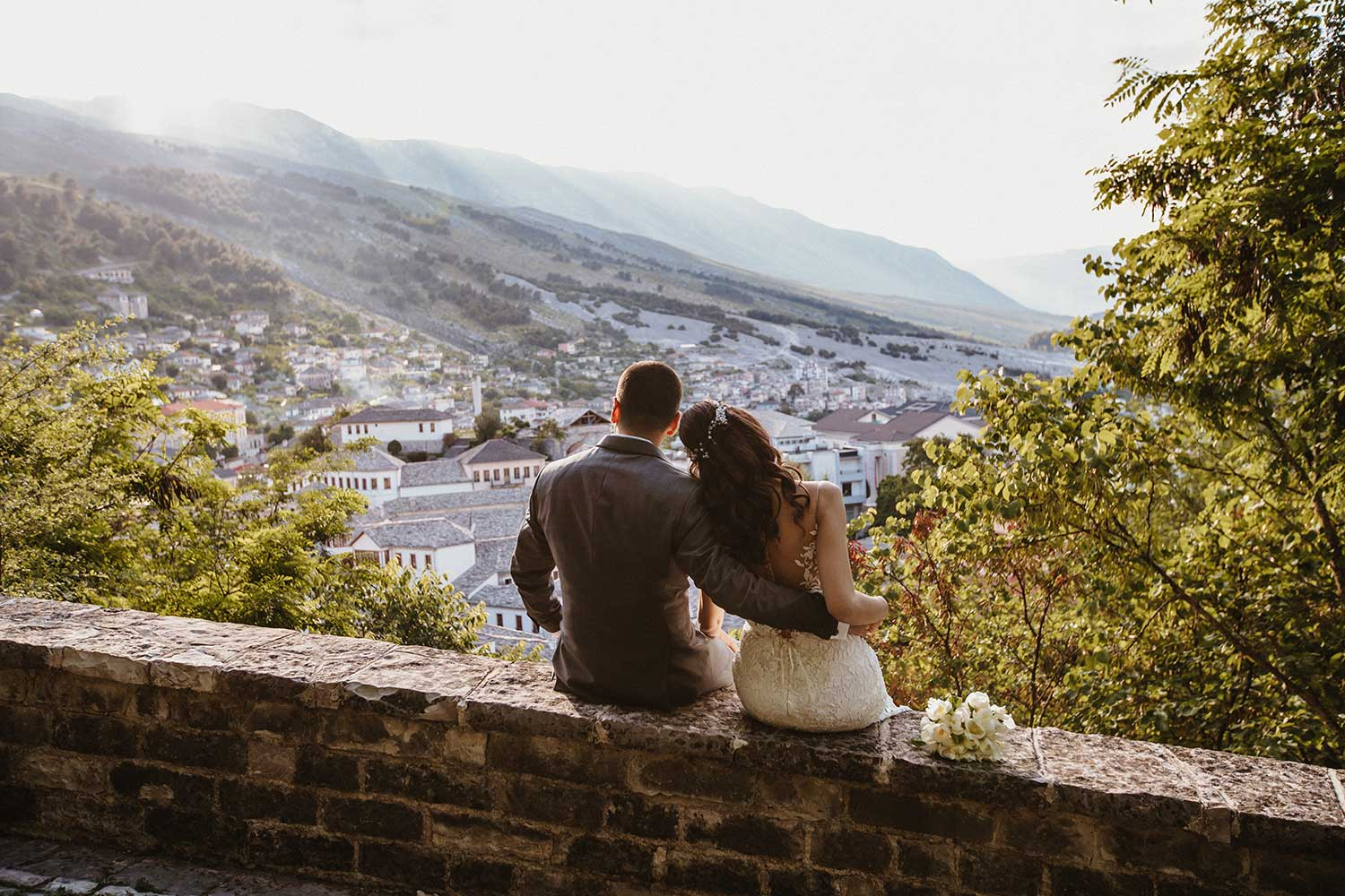 Bride and groom posing in Gjirokaster Castle