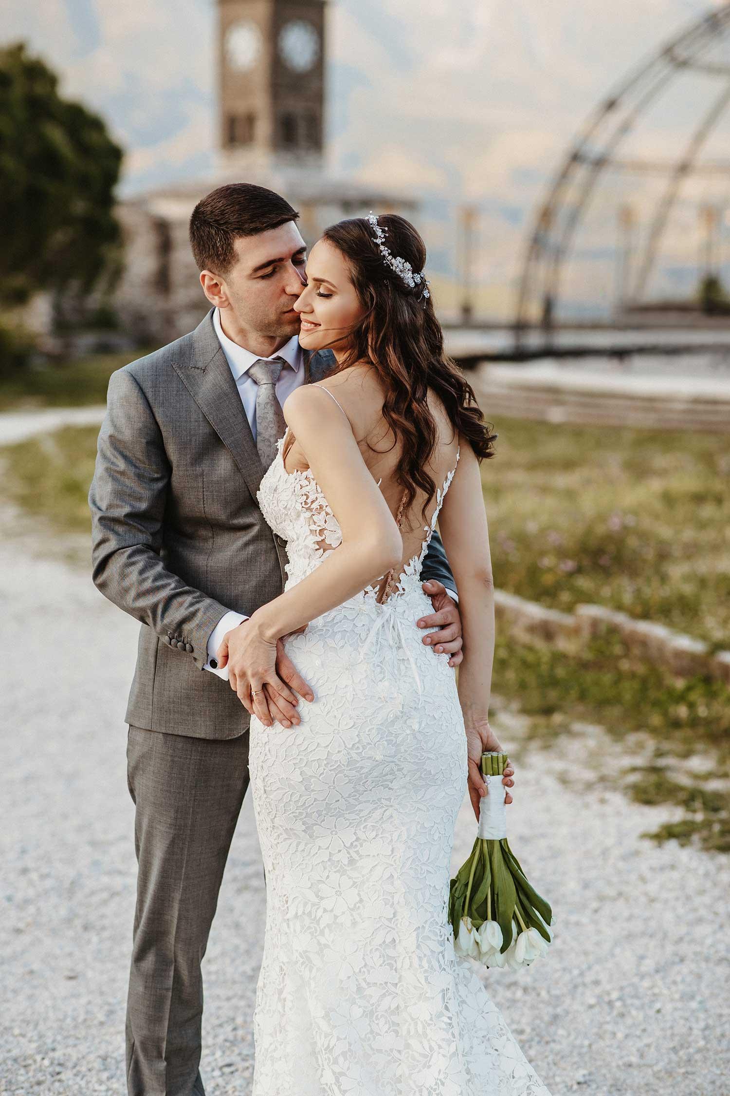 Bride and groom sharing their love in Gjirokaster's castle