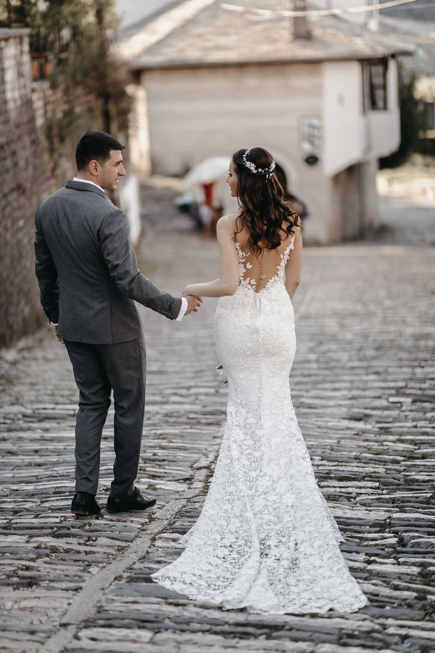 Bride and groom walking down the streets together