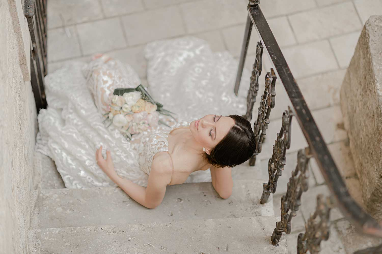 Bride posing in the stairs of Budva