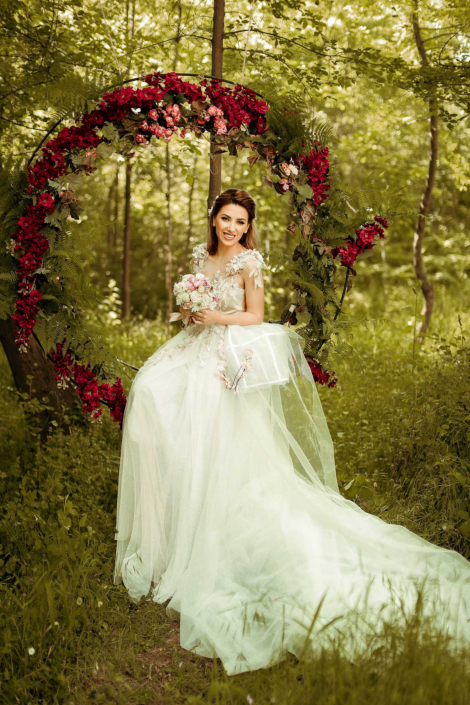 Bride posing with red flowers