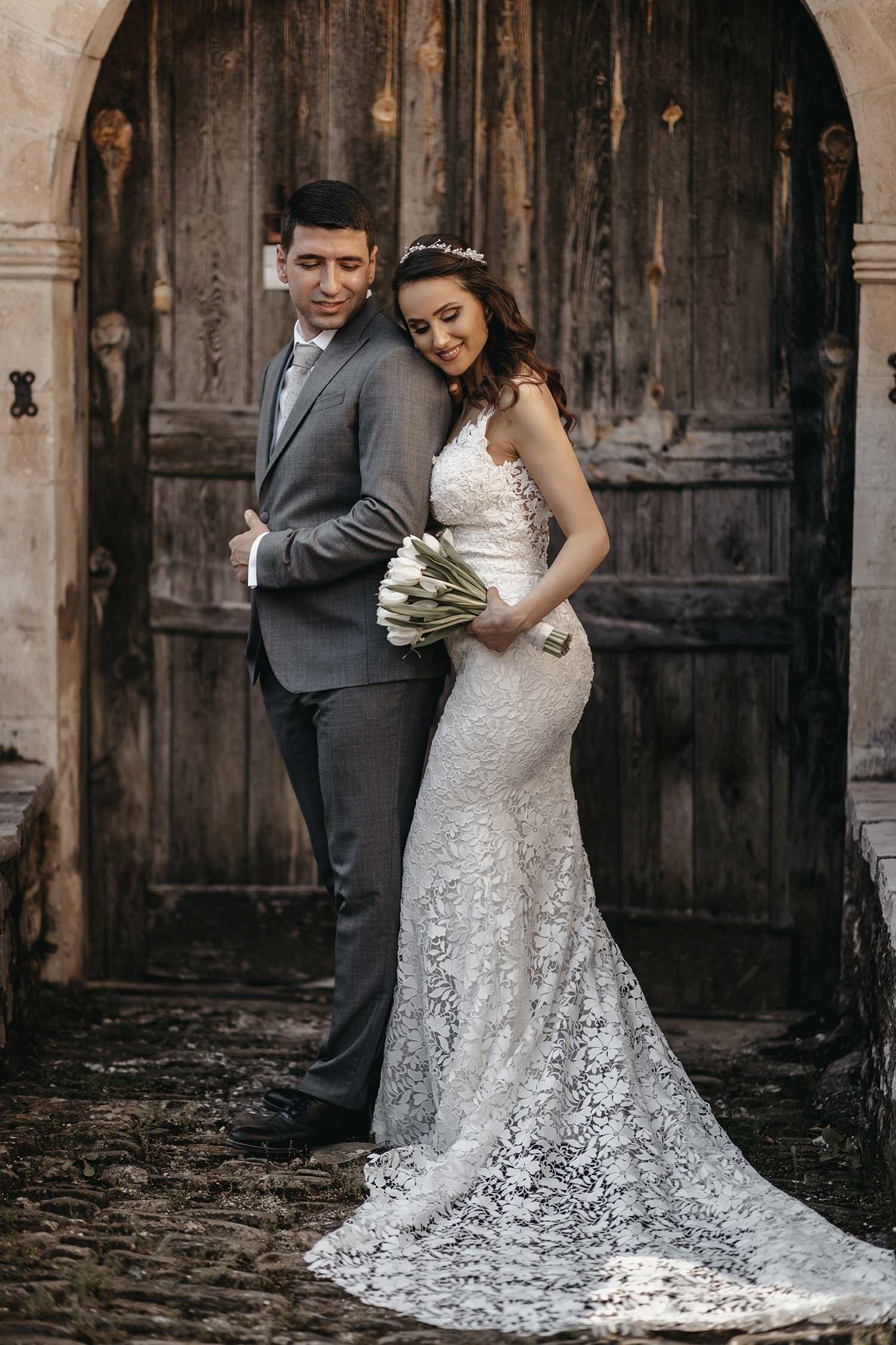 Couple posing in front of an old door