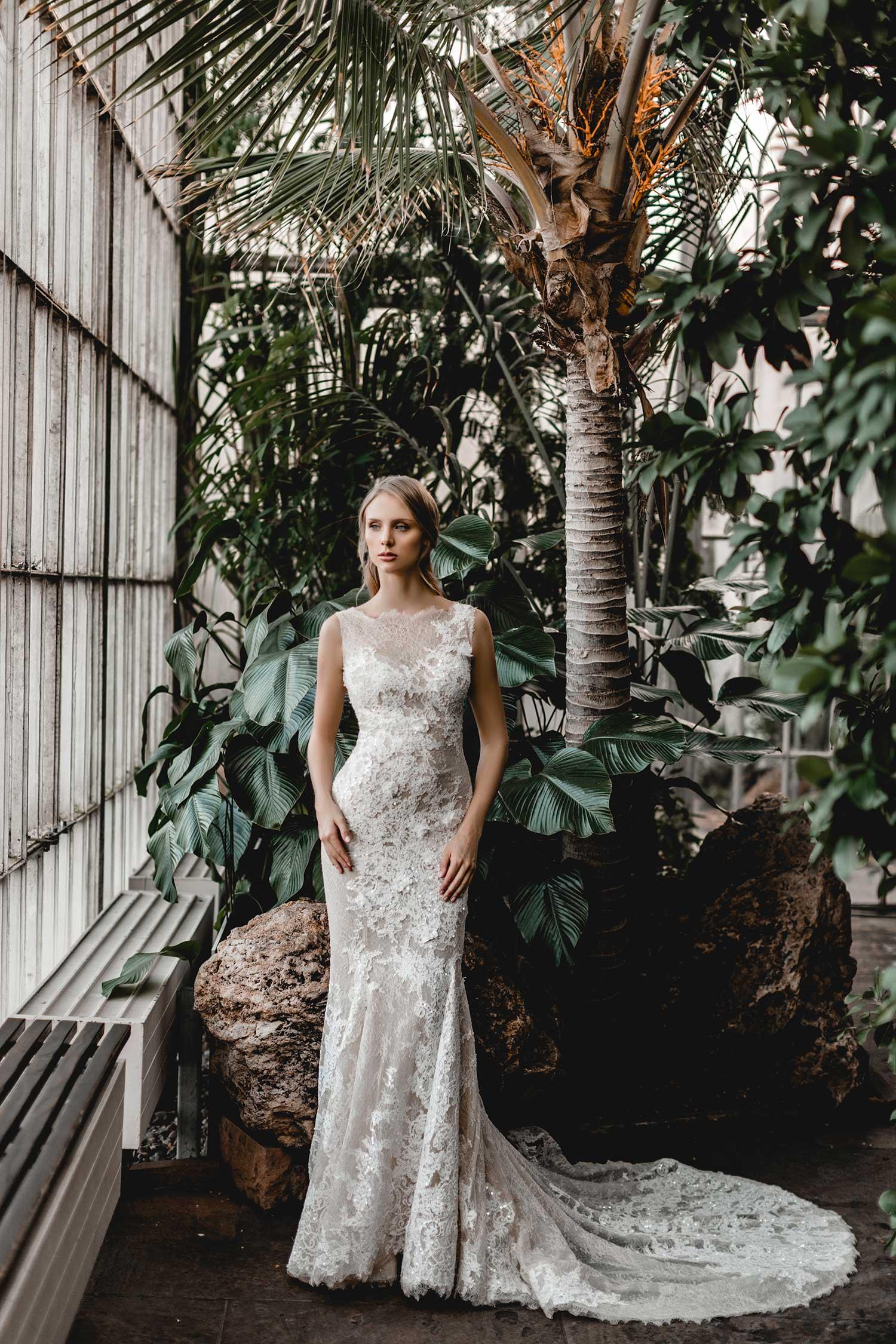 Elegant bridal model in botanic garden