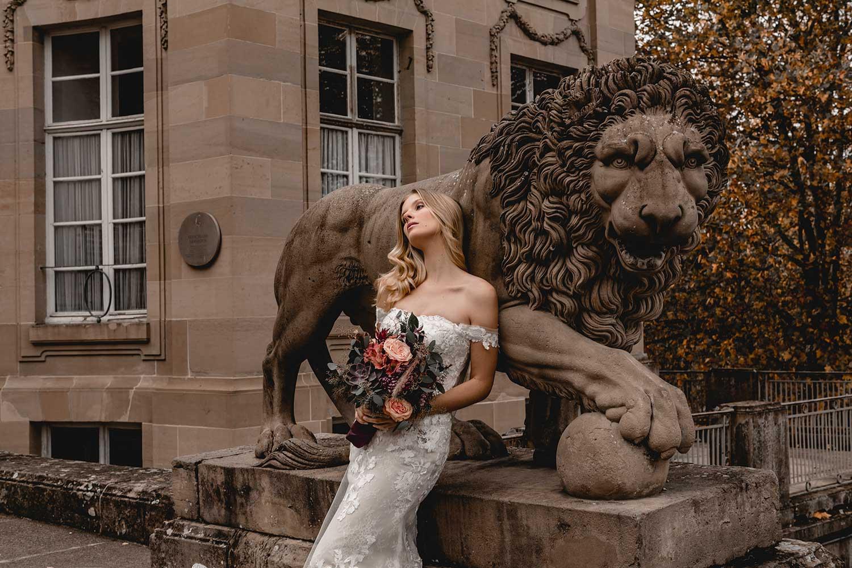 Model posing near a statue