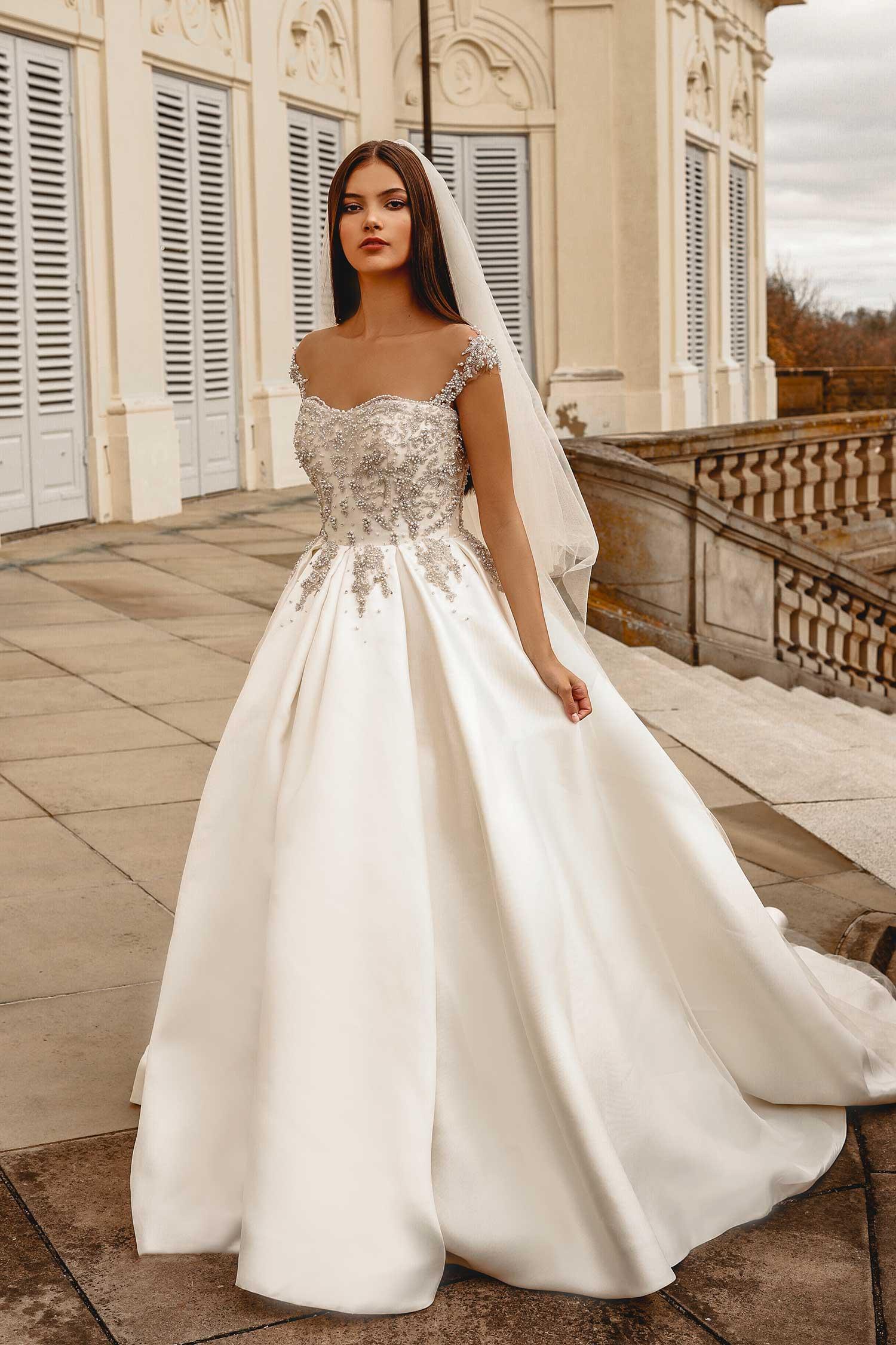 Model wearing a ball gown wedding dress