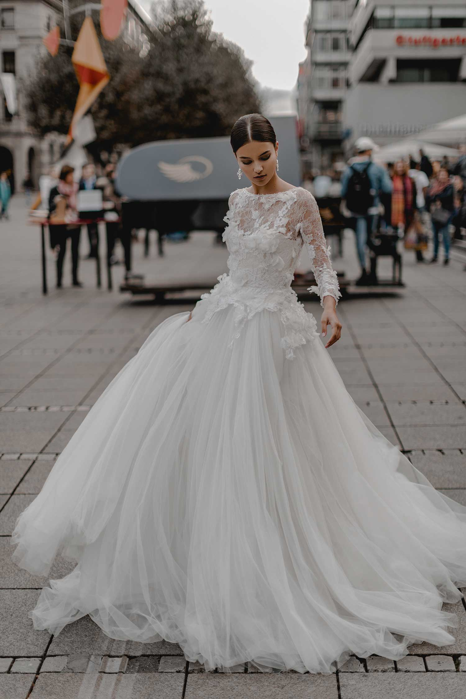 Posing in the city with a wedding dress