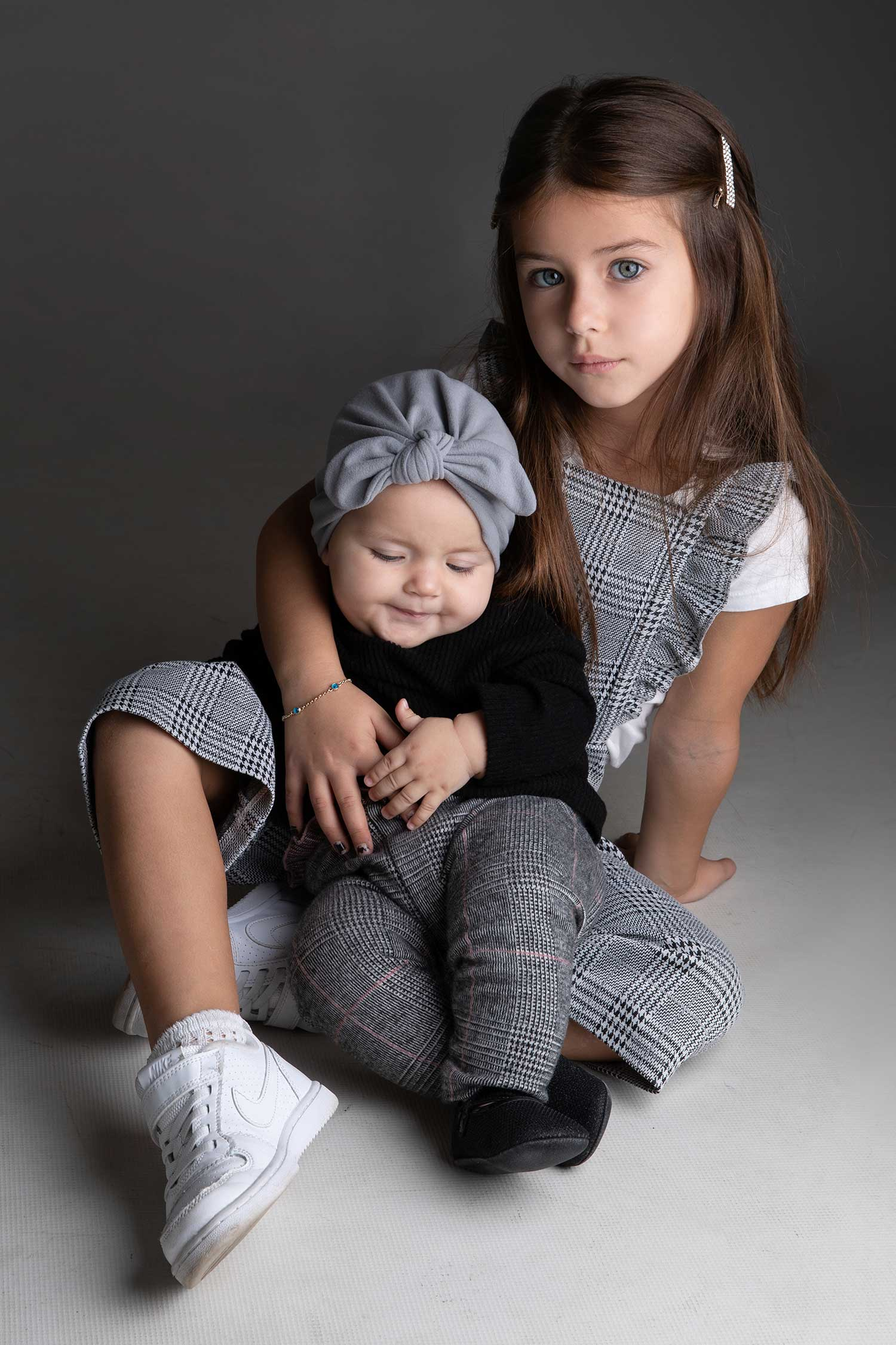 Studio family portraits - Special bond between sisters