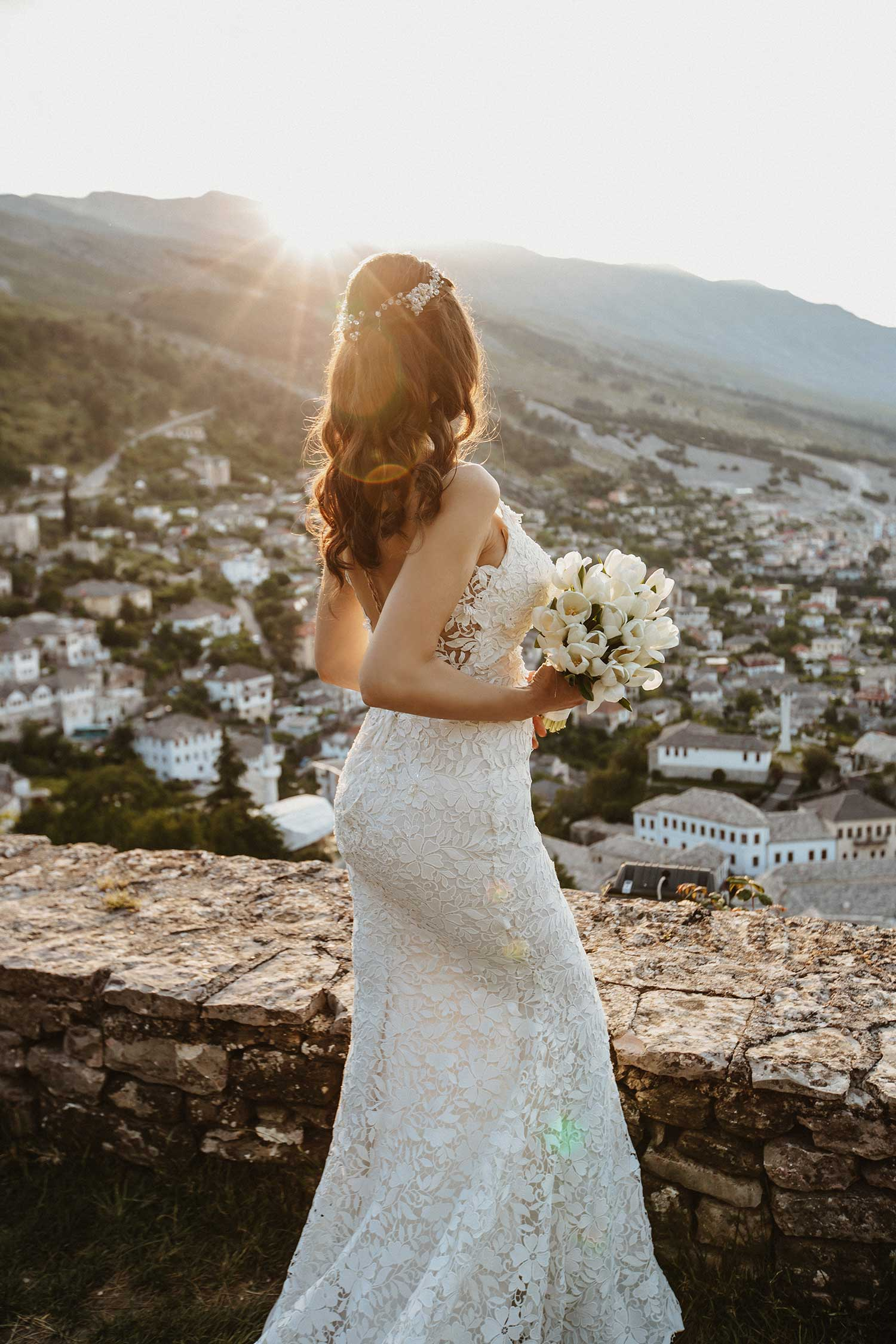 Sun light illuminating bride's wedding dress