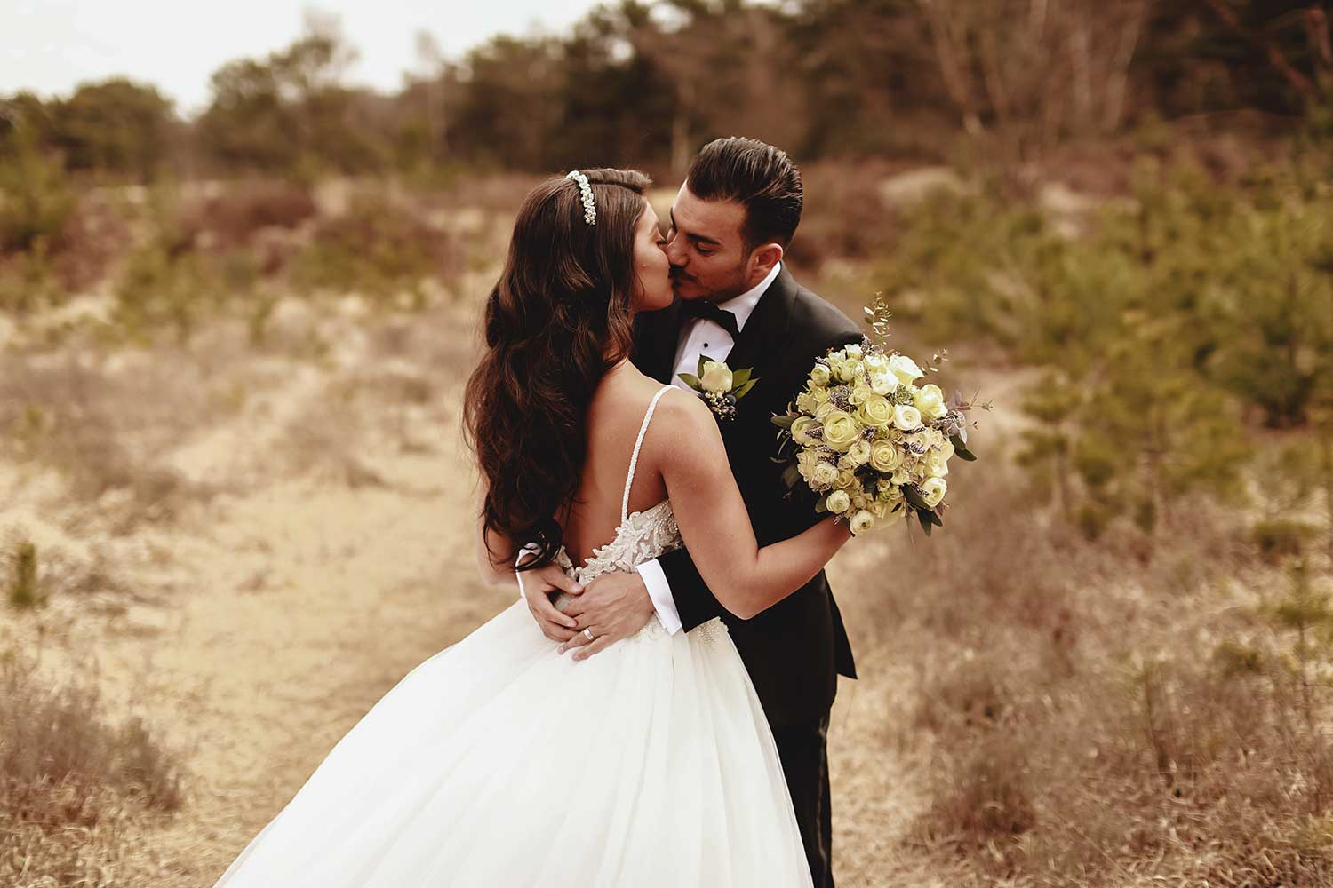 The couple kissing