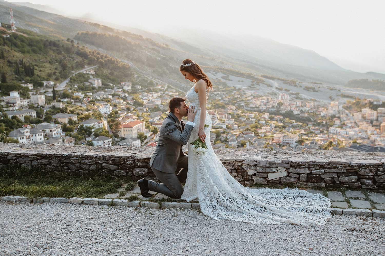 The groom kissing the bride's cute bump