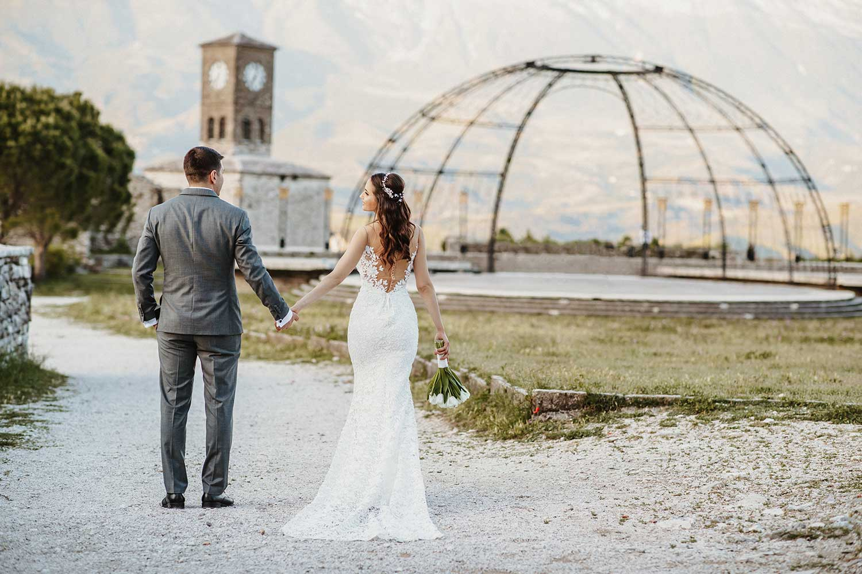 The wedding couple walking together