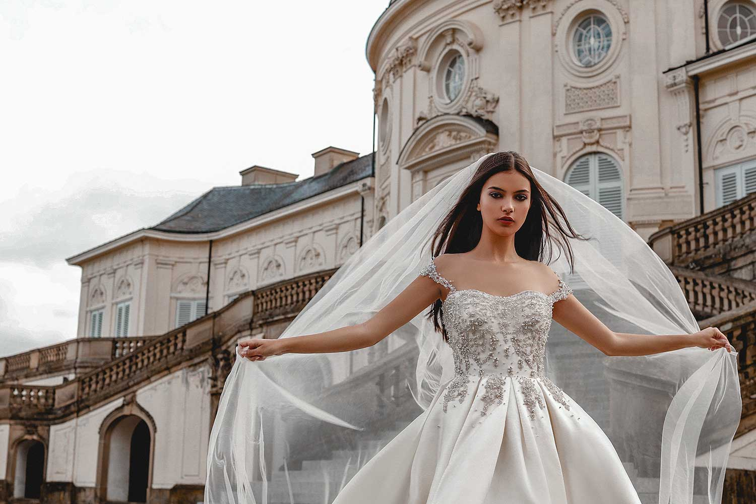 The wind playing with the bridal model's veil