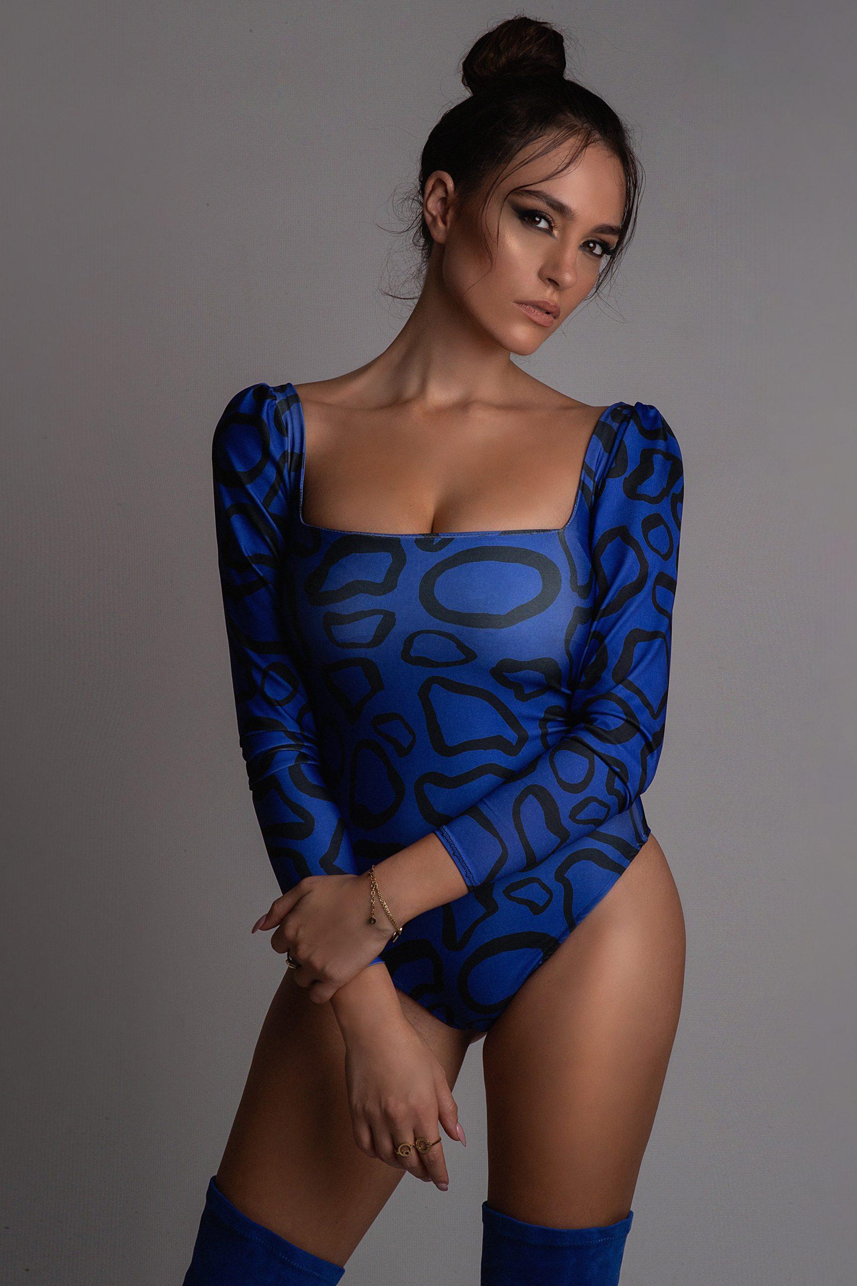 Celebrity wearing a blue patterned bodysuit