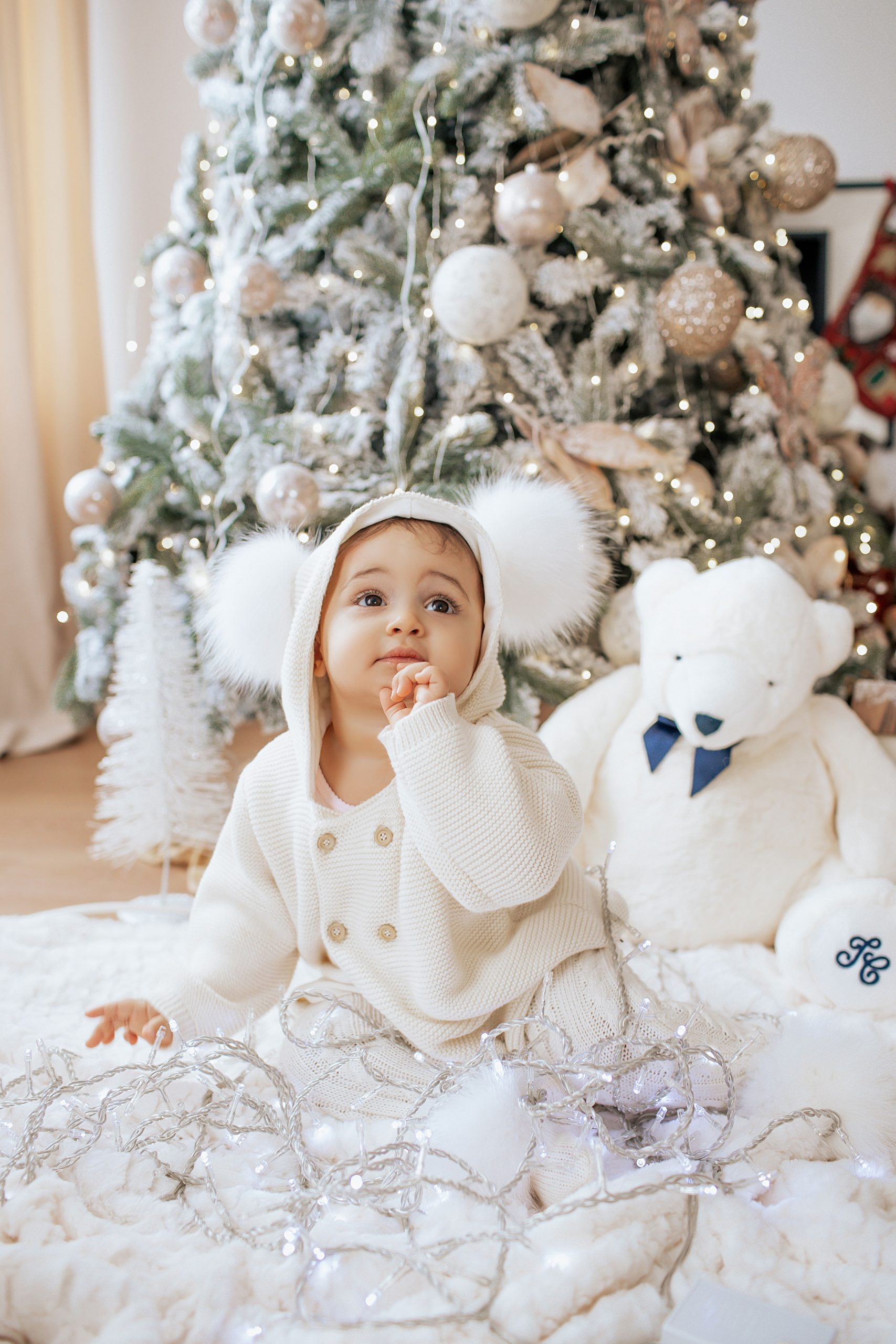 Baby wearing white Christmas outfit