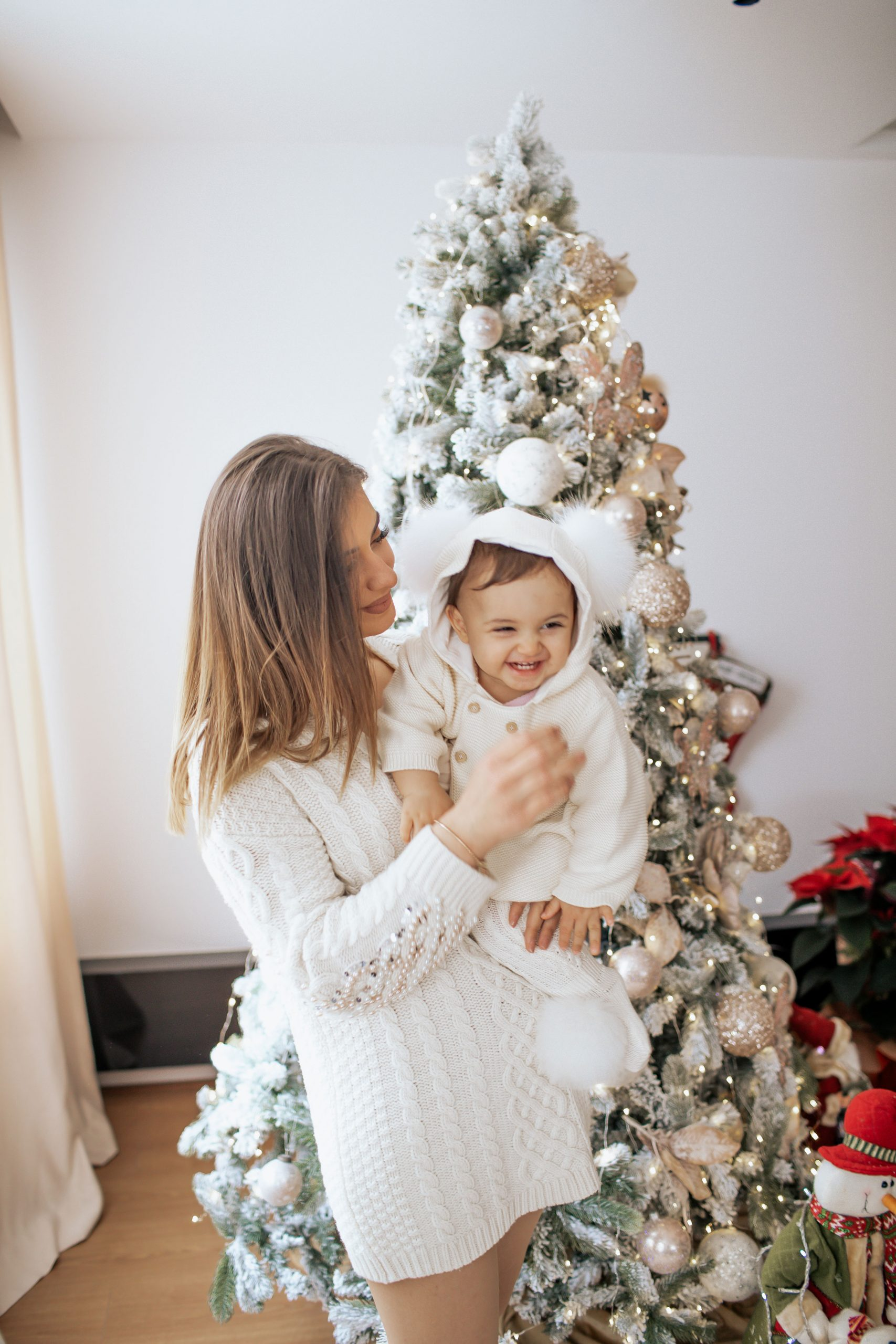 Mother and baby having fun in the Christmas photoshoot