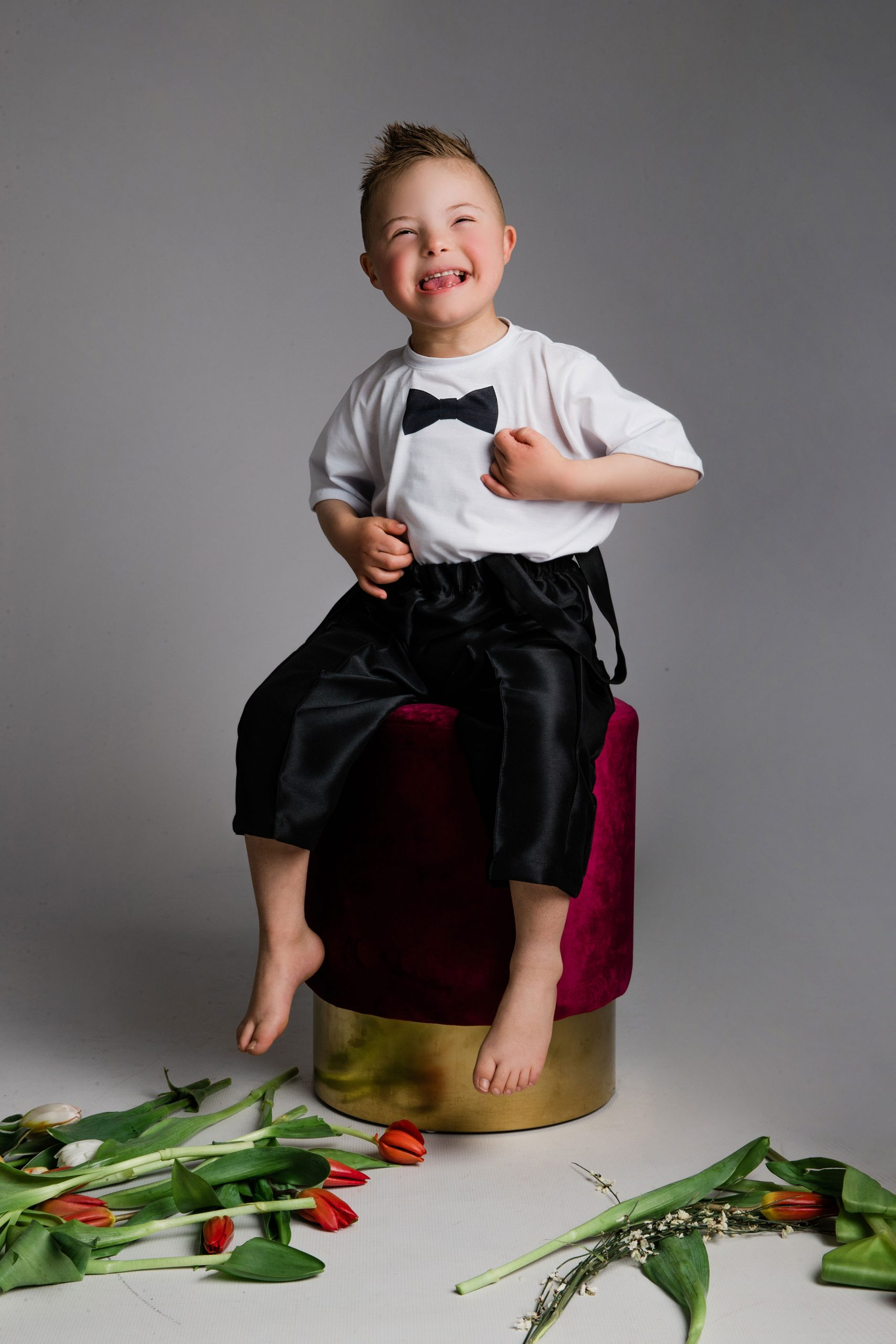 Little boy laughing and having a good time at the studio