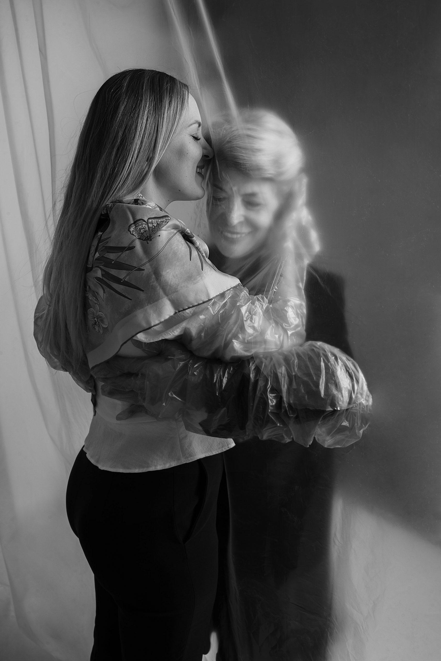Safe Hugs- Mother and daughter photo studio portrait