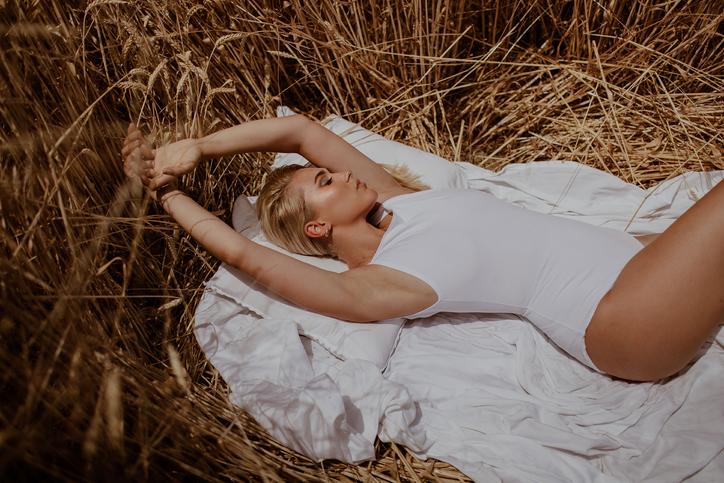 Girl laying in the middle of a Wheatfield
