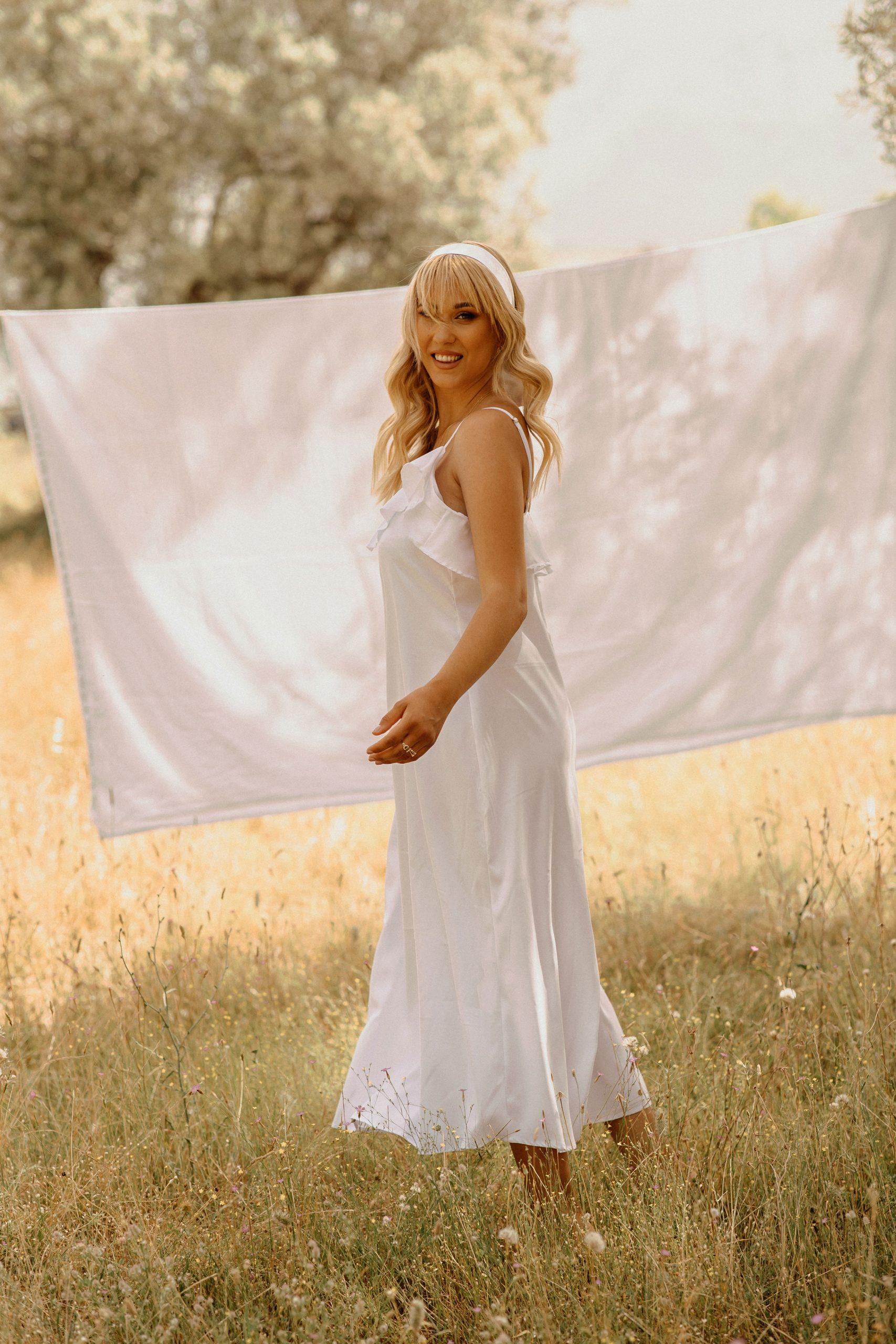 Pretty blonde posing in a clothesline in a Wheatfield