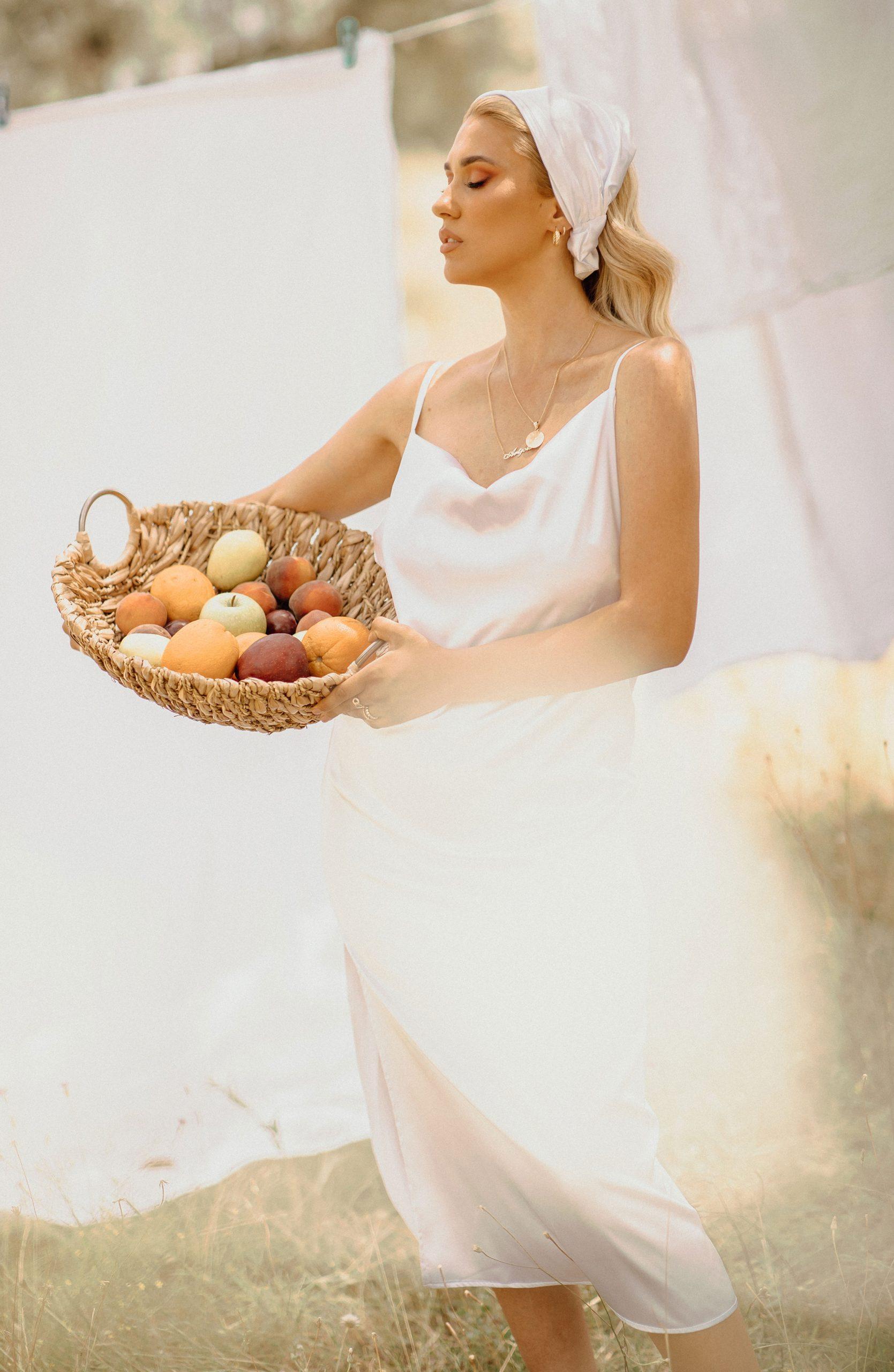 Summer photoshoot in a field wearing white dress
