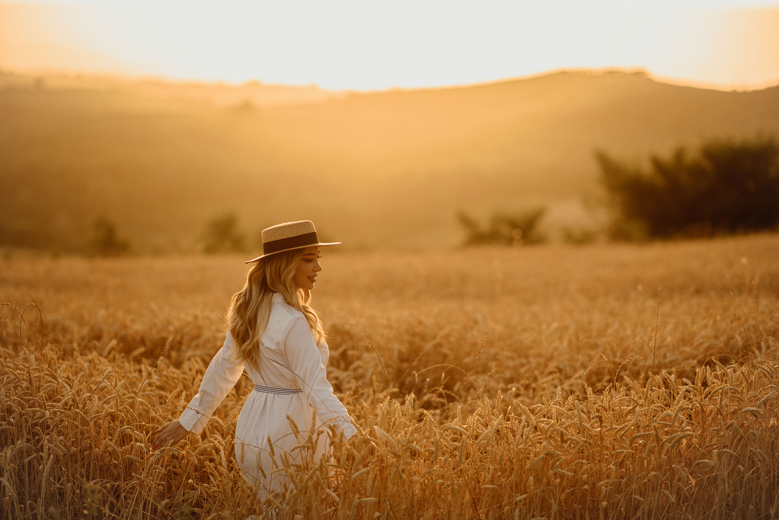 Adisa Gjo posing in a golden field during golden hour
