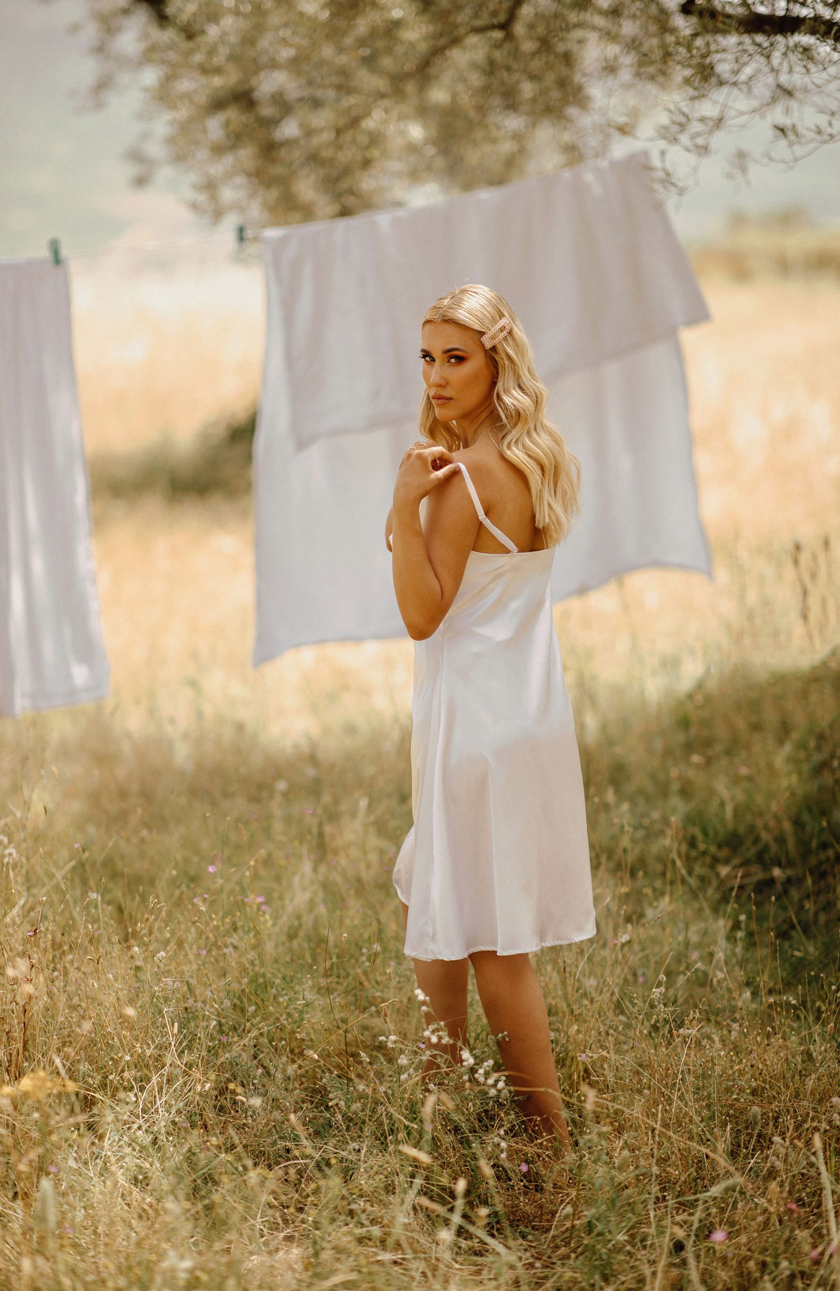 Beautiful posing near a clothesline
