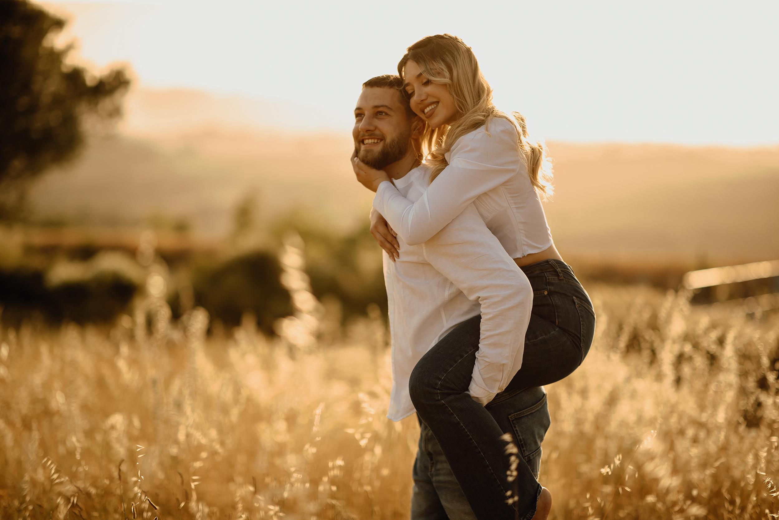 Boyfriend giving his girlfriend a piggyback ride to his girlfriend