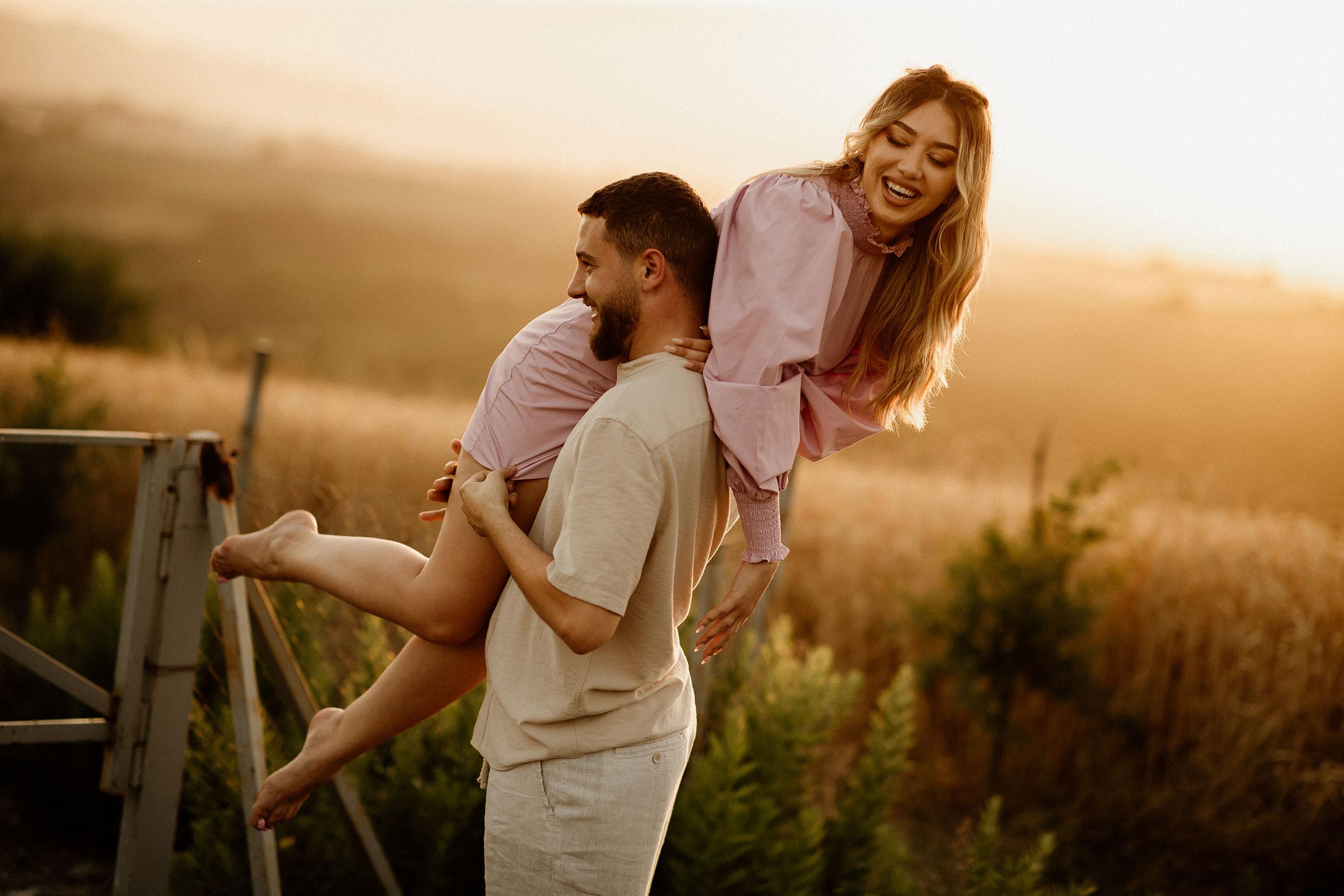 Boyfriend lifting Adisa Gjo and having a laugh together