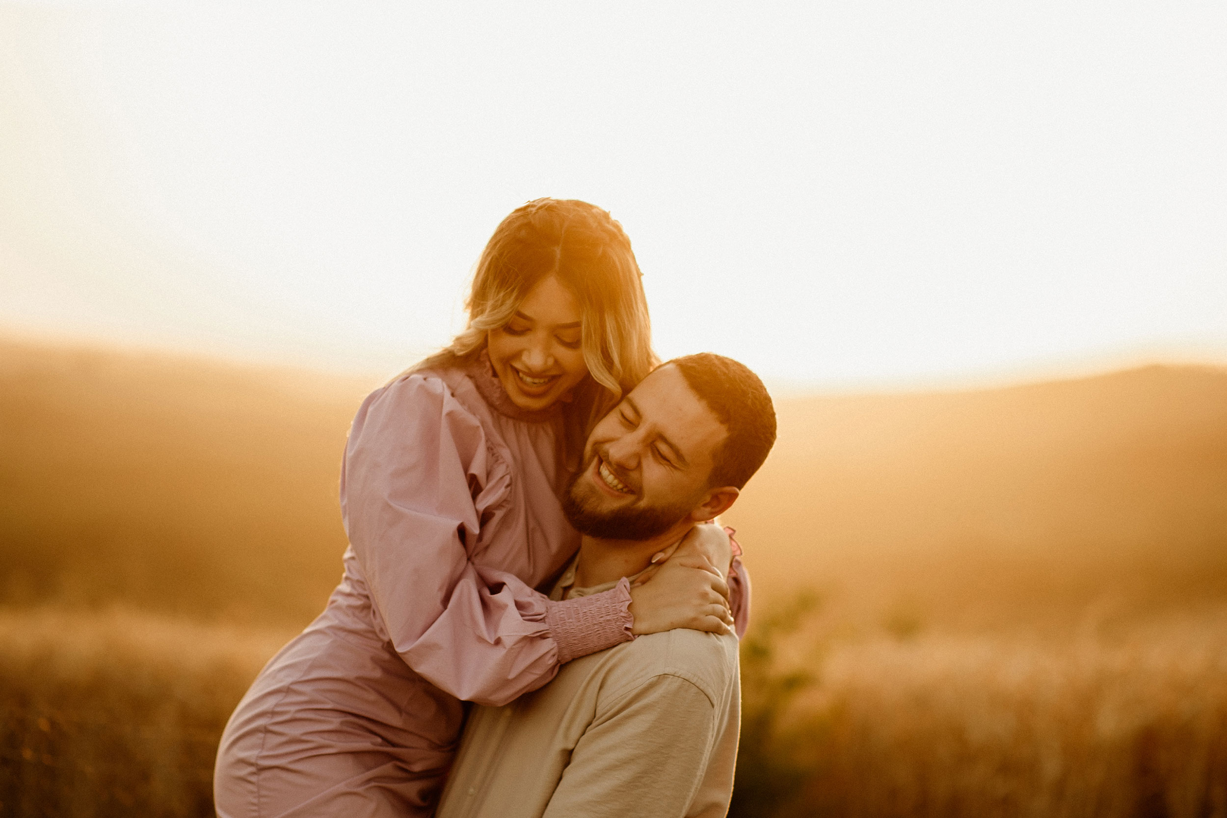 Couple laughing and posing with each other