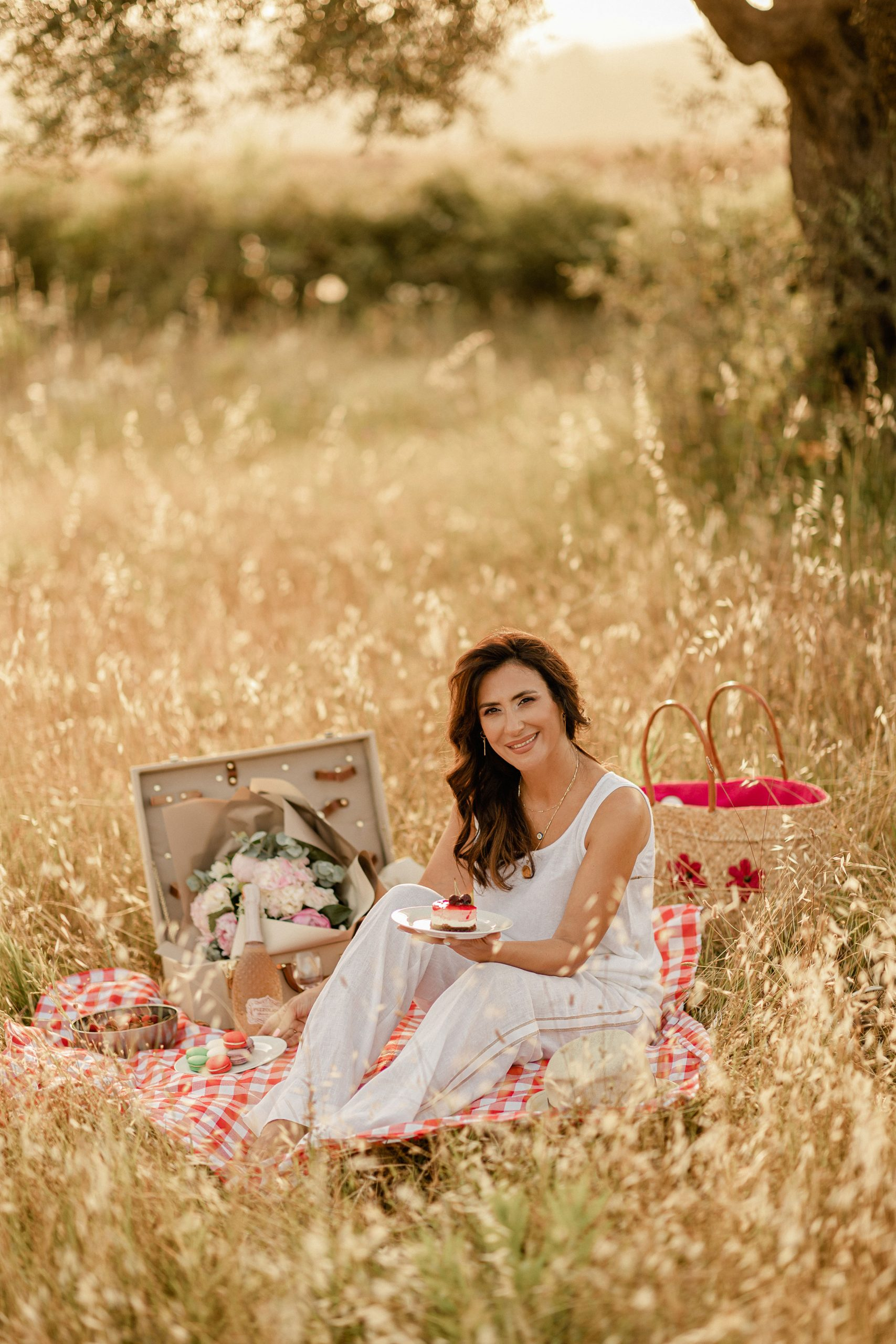 Iva Tico during a picnic photoshoot with a dessert in her hand