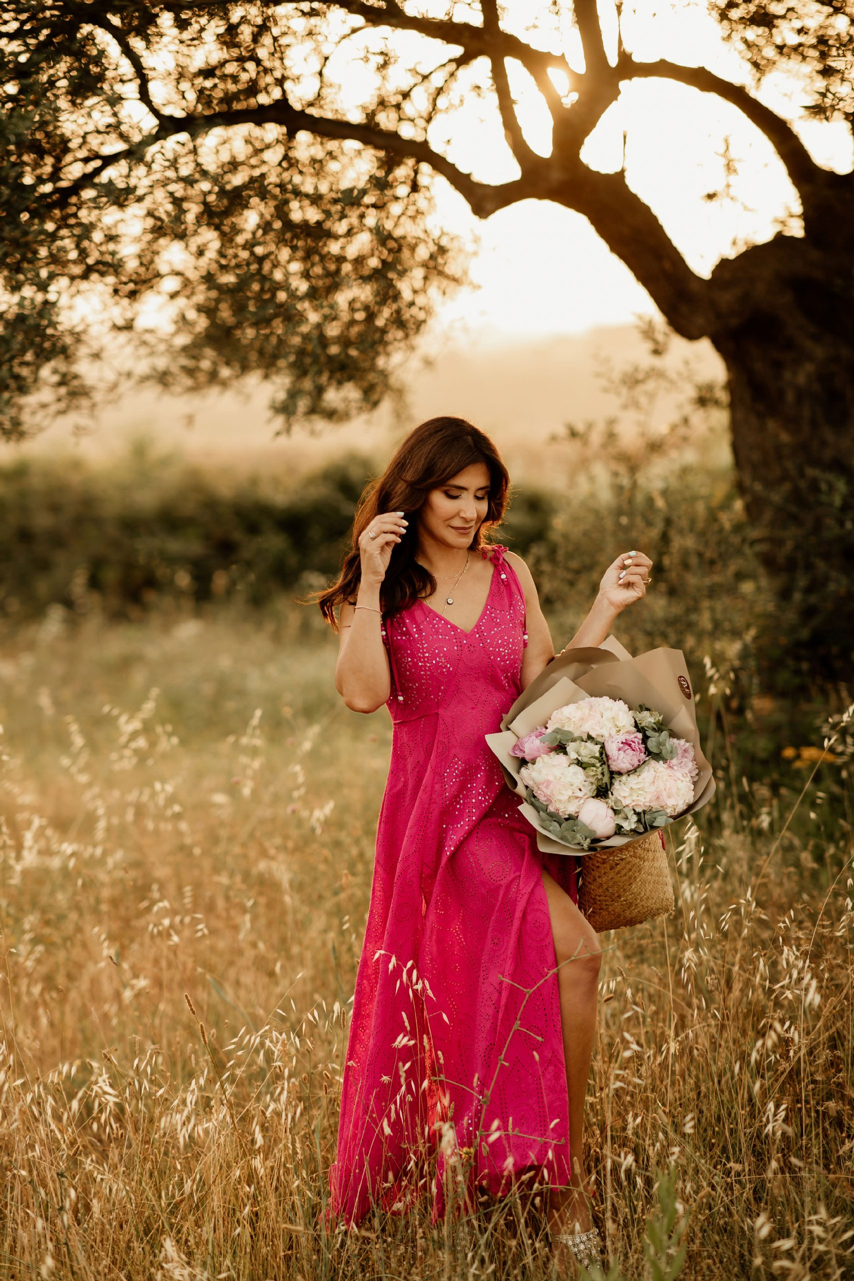 Iva Tico walking on the field holding flowers