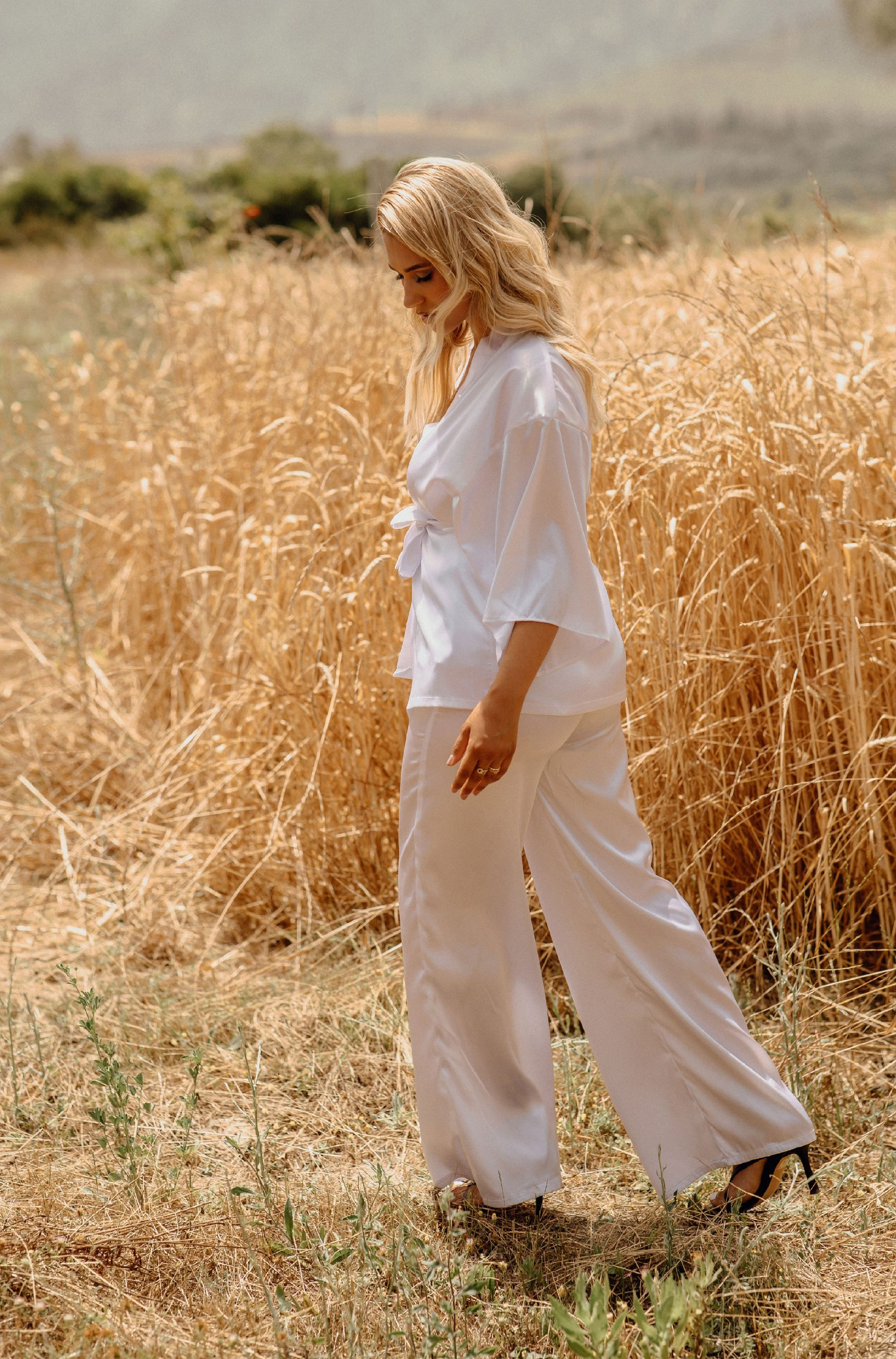 Wearing a white two pieces in a Wheatfield